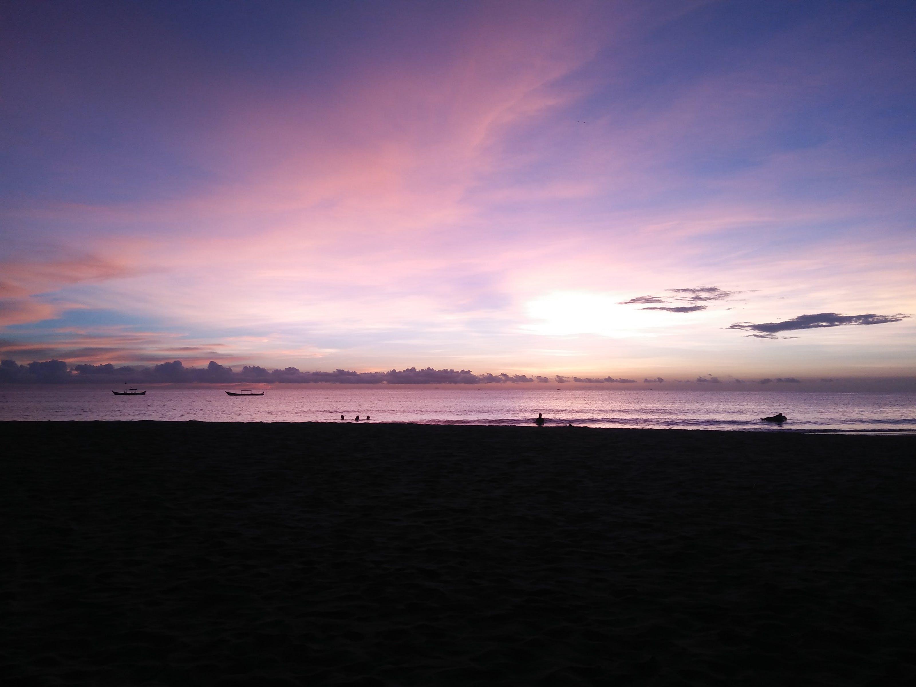 Ilmainen kuvapankkikuva tunnisteilla aallot, auringonlasku, hiekka, hiekkaranta