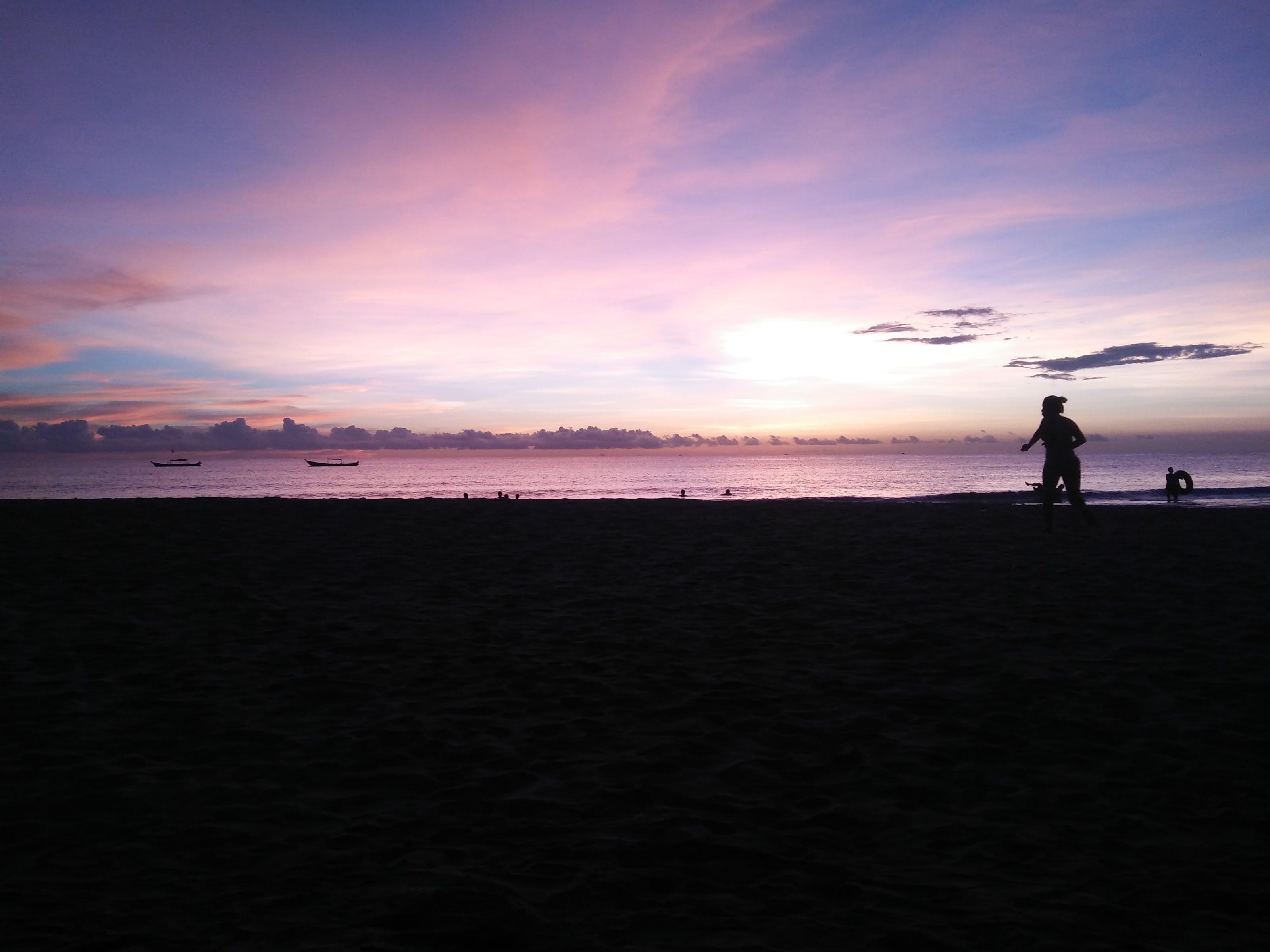 Silhouette of Person Near Sea