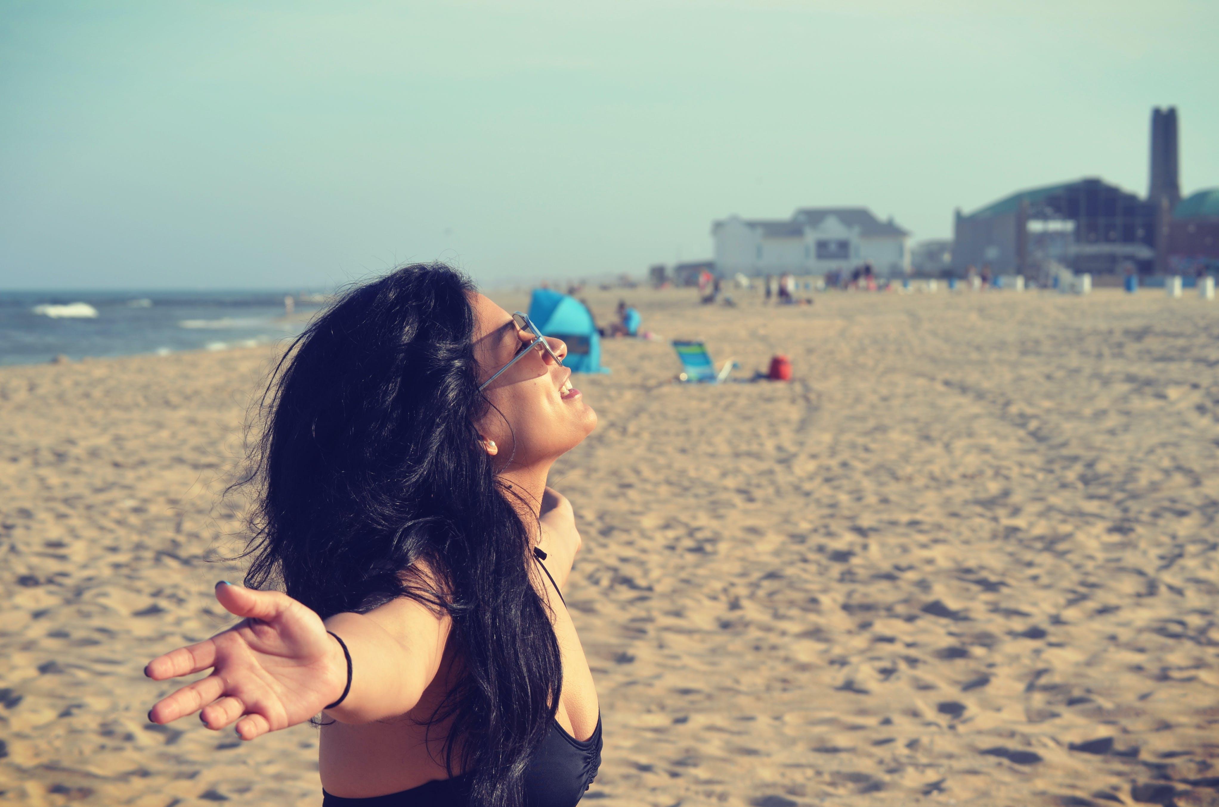 Woman in Black Bra at Beach
