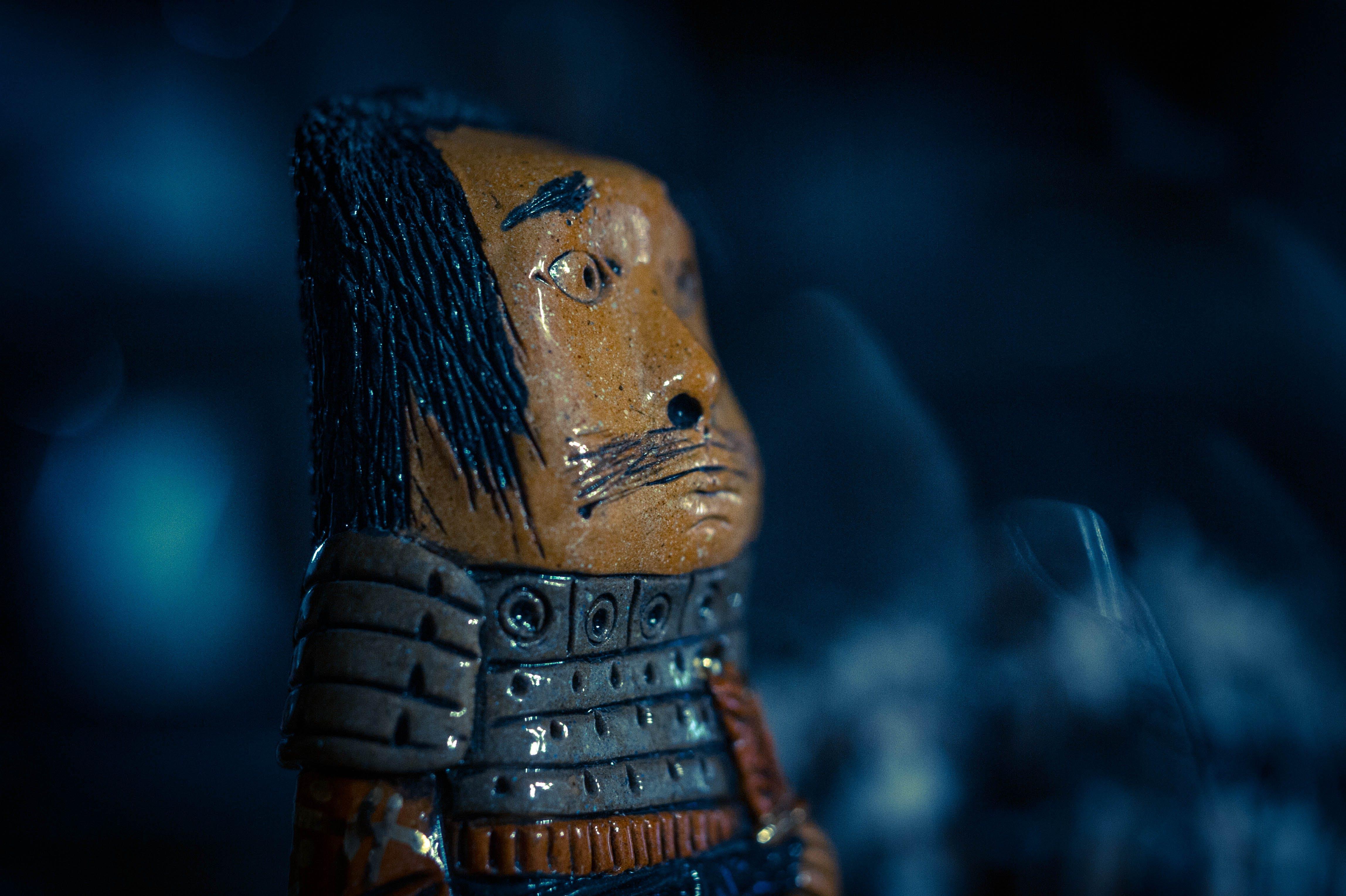 Brown and Gray Warrior Figure Closeup Photo