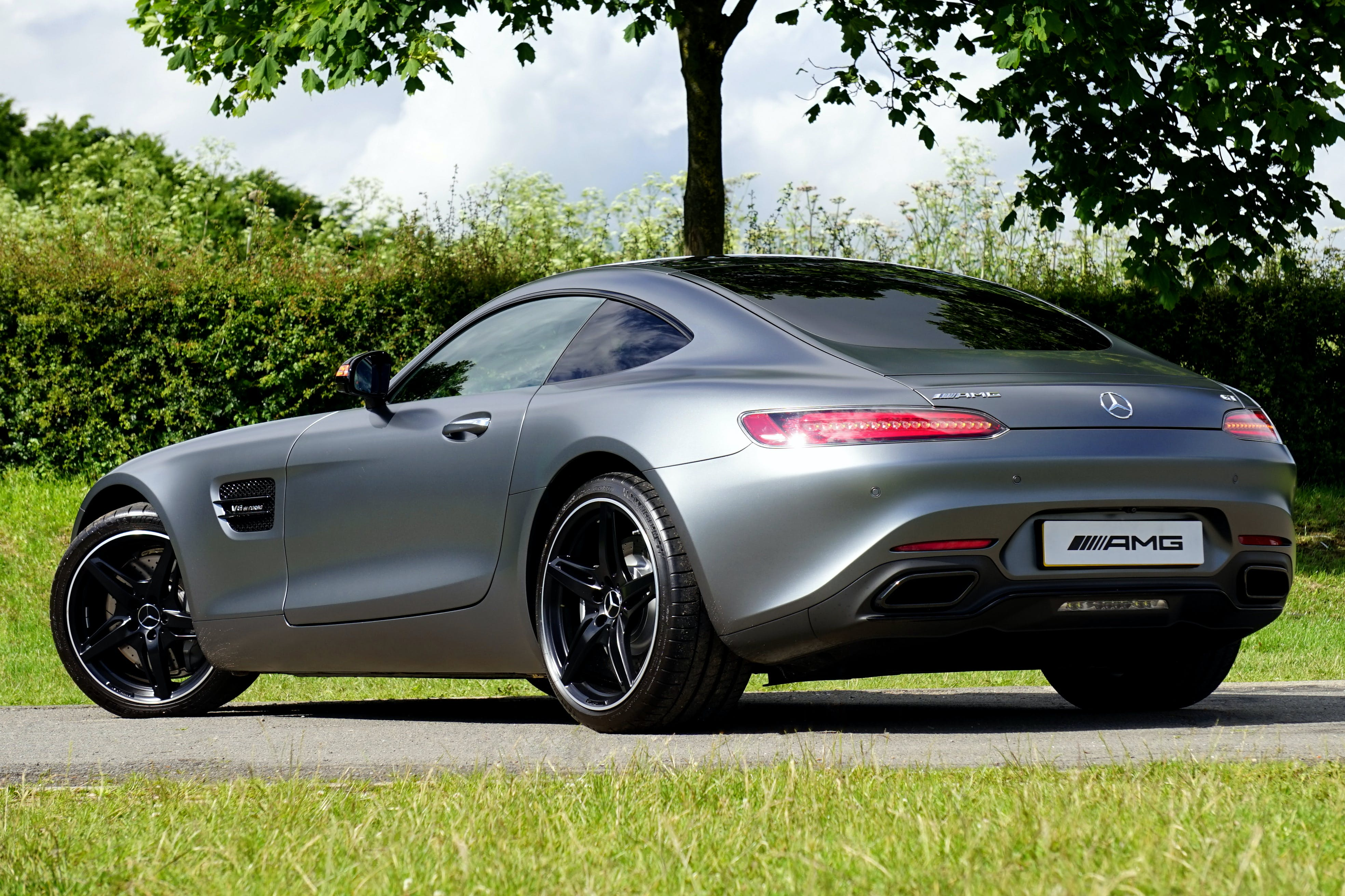 Gray Mercedes-benz Amg Coupe Parked Near Tree