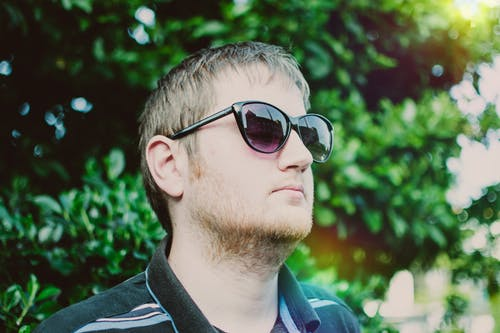 Man Wearing Black Sunglasses and Polo Shirt