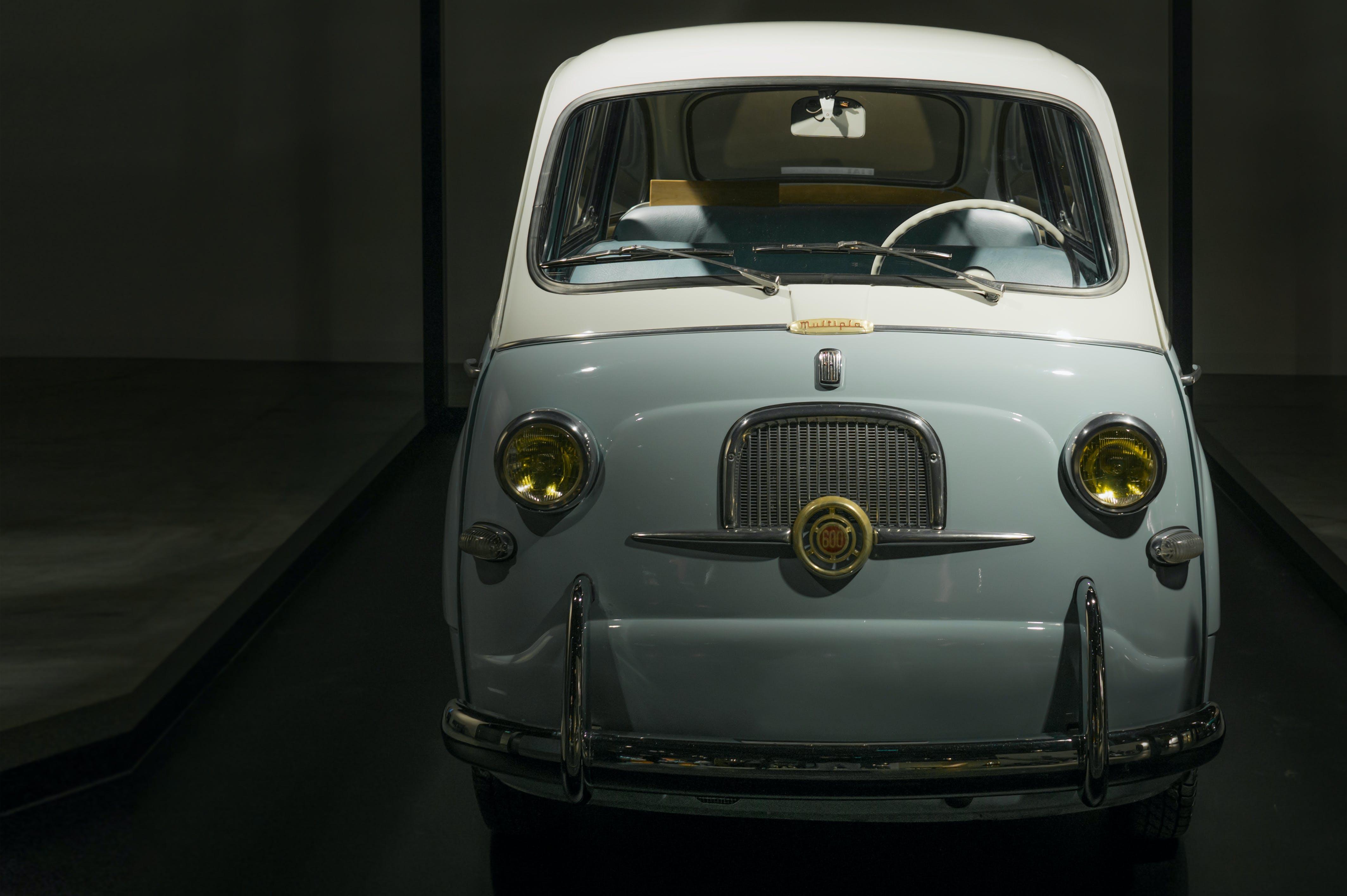 White and Gray Cadillac Car