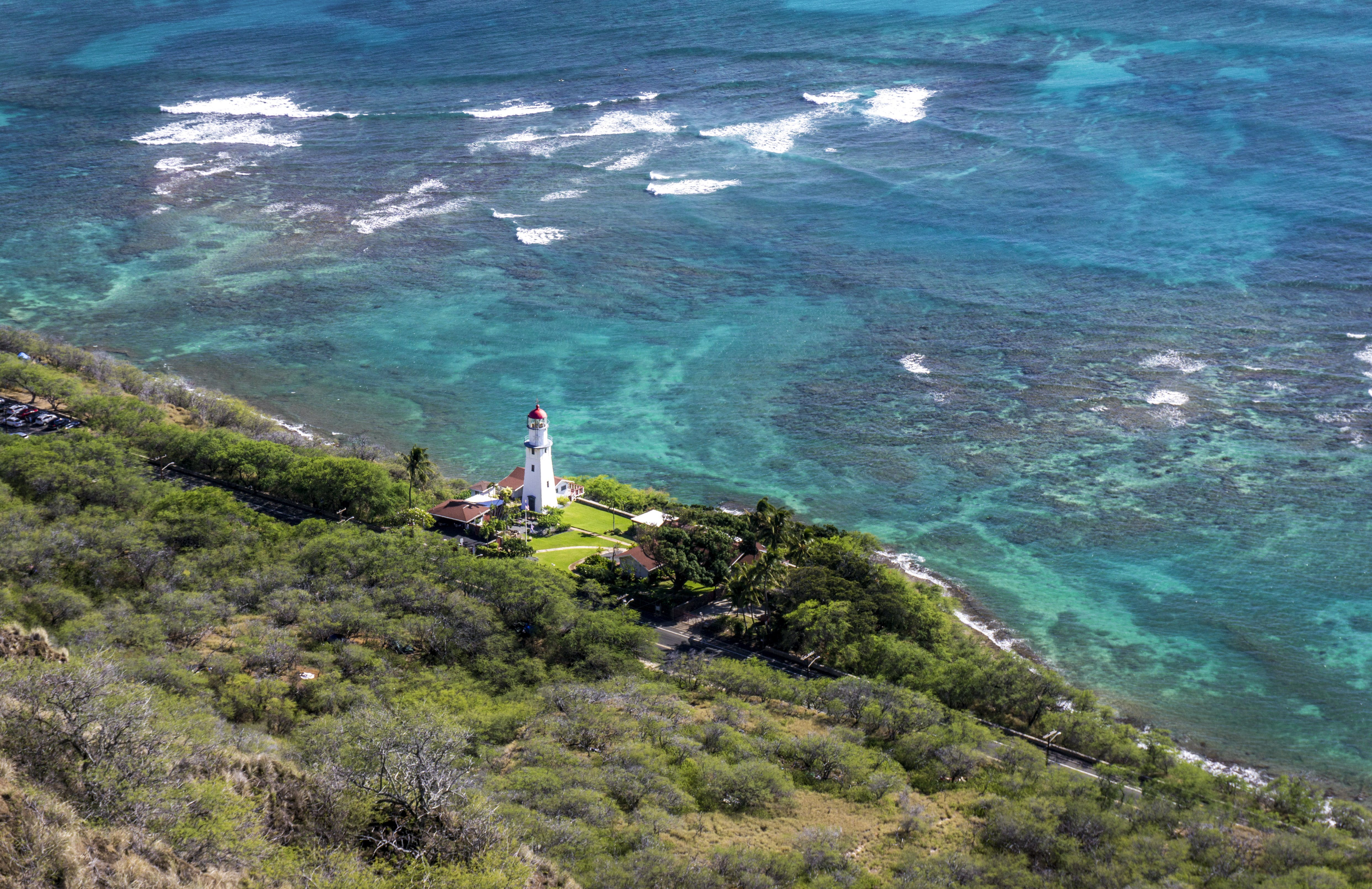 Aerial Photo of White Lighthouse Near Beach and Trees