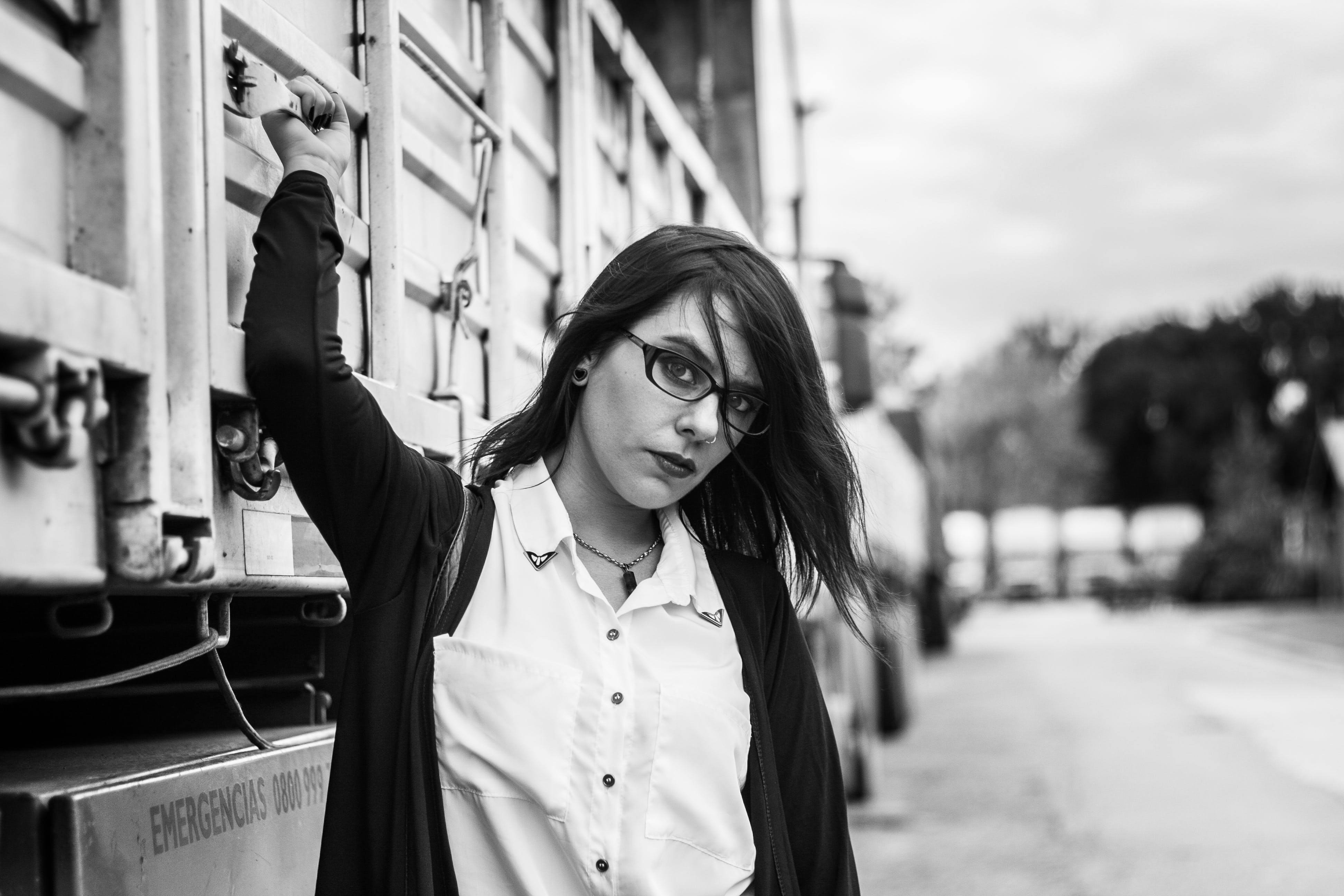 Woman With Zip-up Jacket Stand Beside Truck