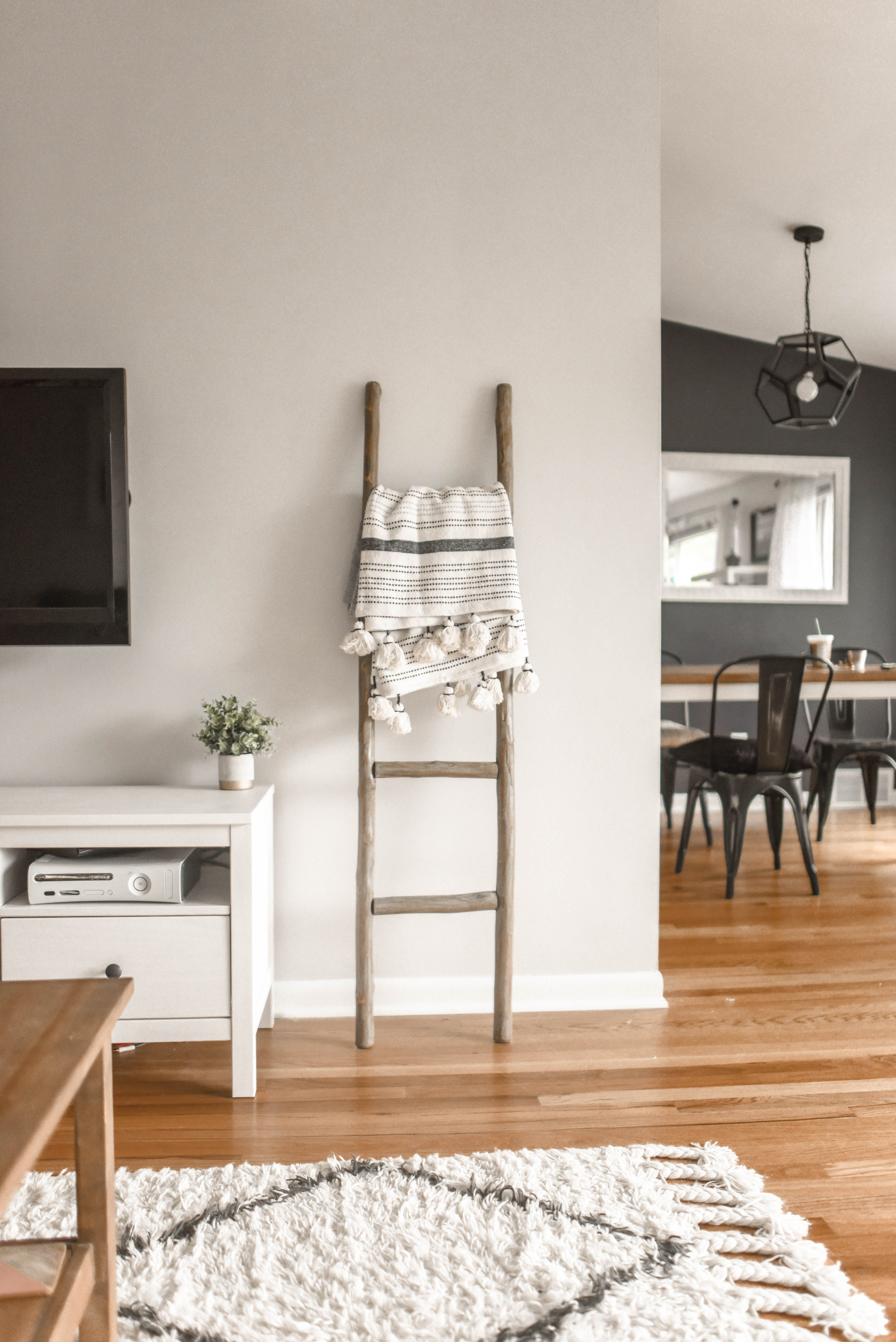 Gray Wooden Ladder on White Painted Wall