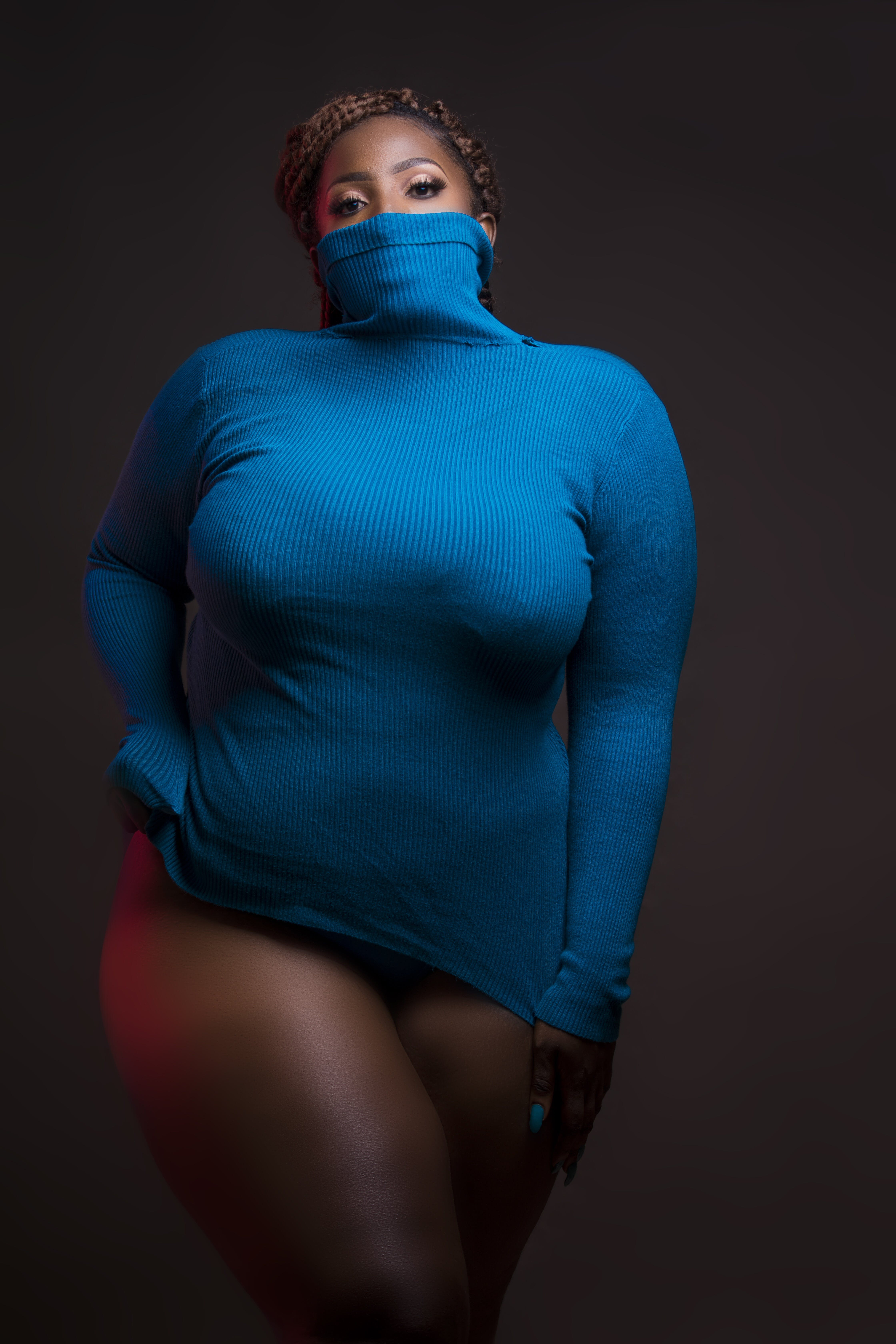 Woman in Blue Turtleneck Sweatshirt