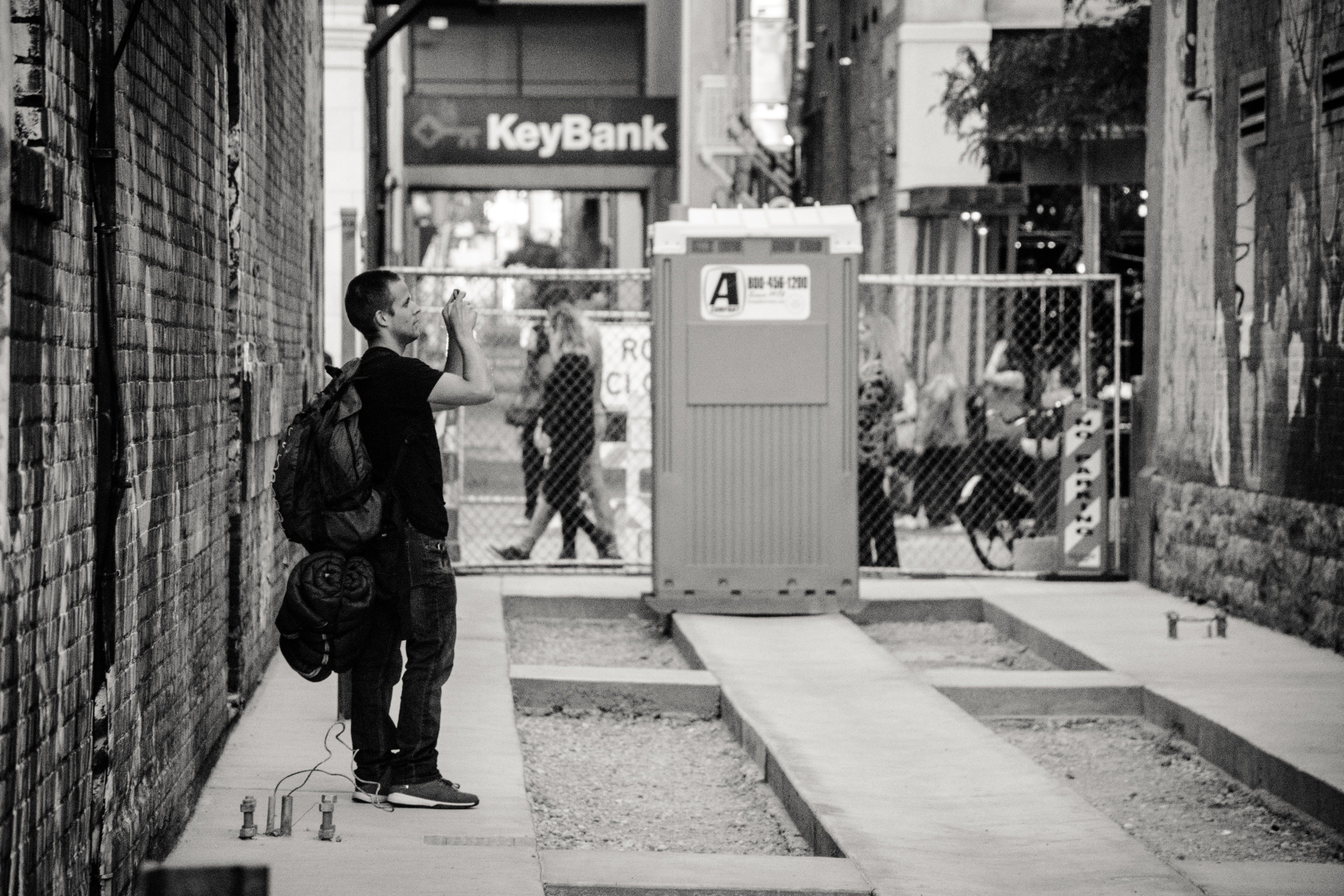 Man Standing Near Keybank Signage