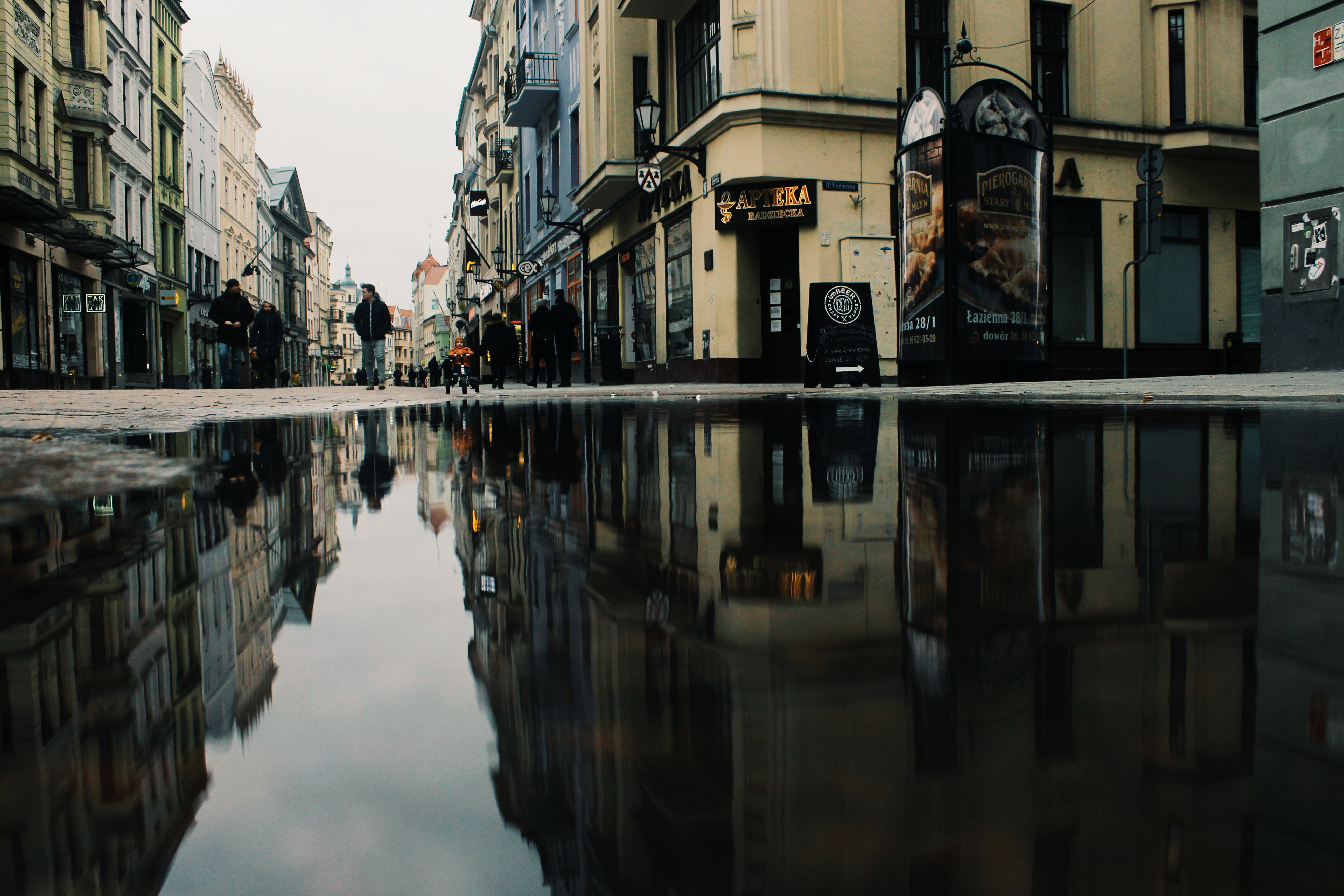 Reflection Of Buildings On Puddle