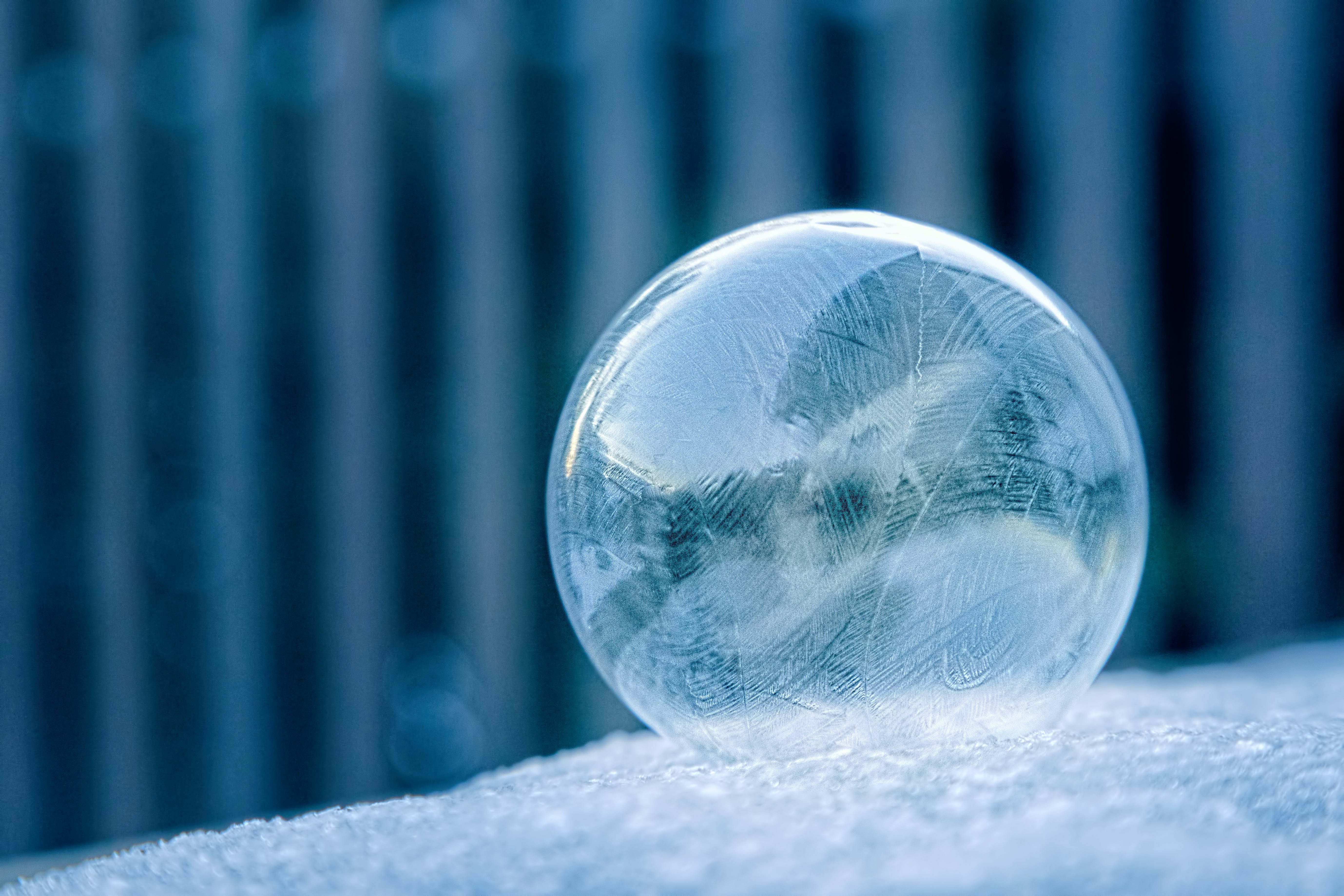 Glass Ball on White Surface