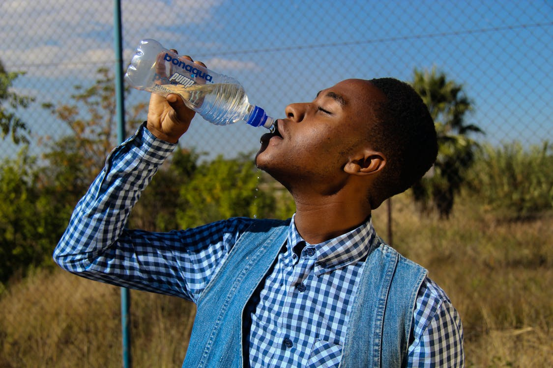 Photography of A Man Drinking Water
