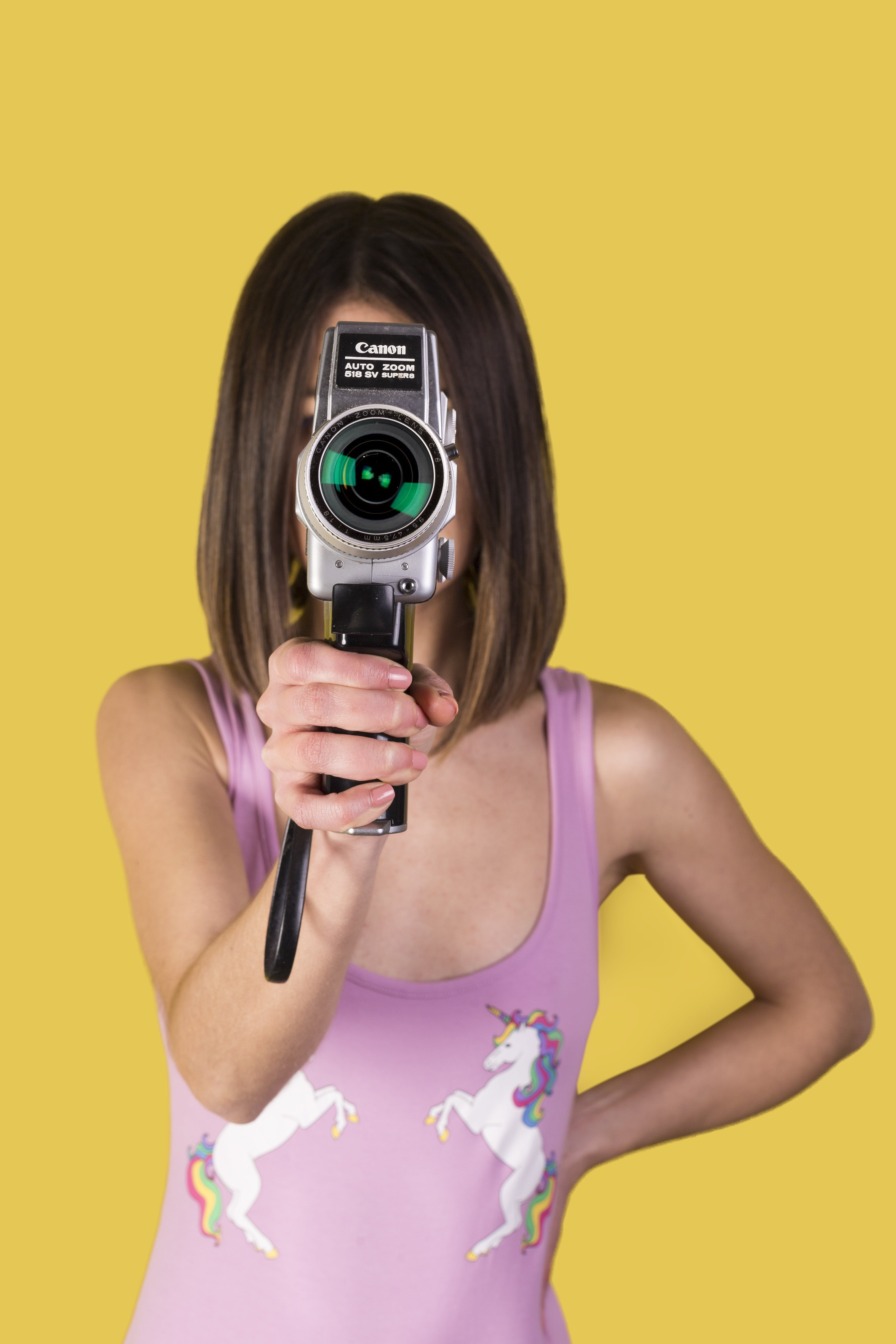 Girl Wearing Purple Tank Top Holding Canon Camera