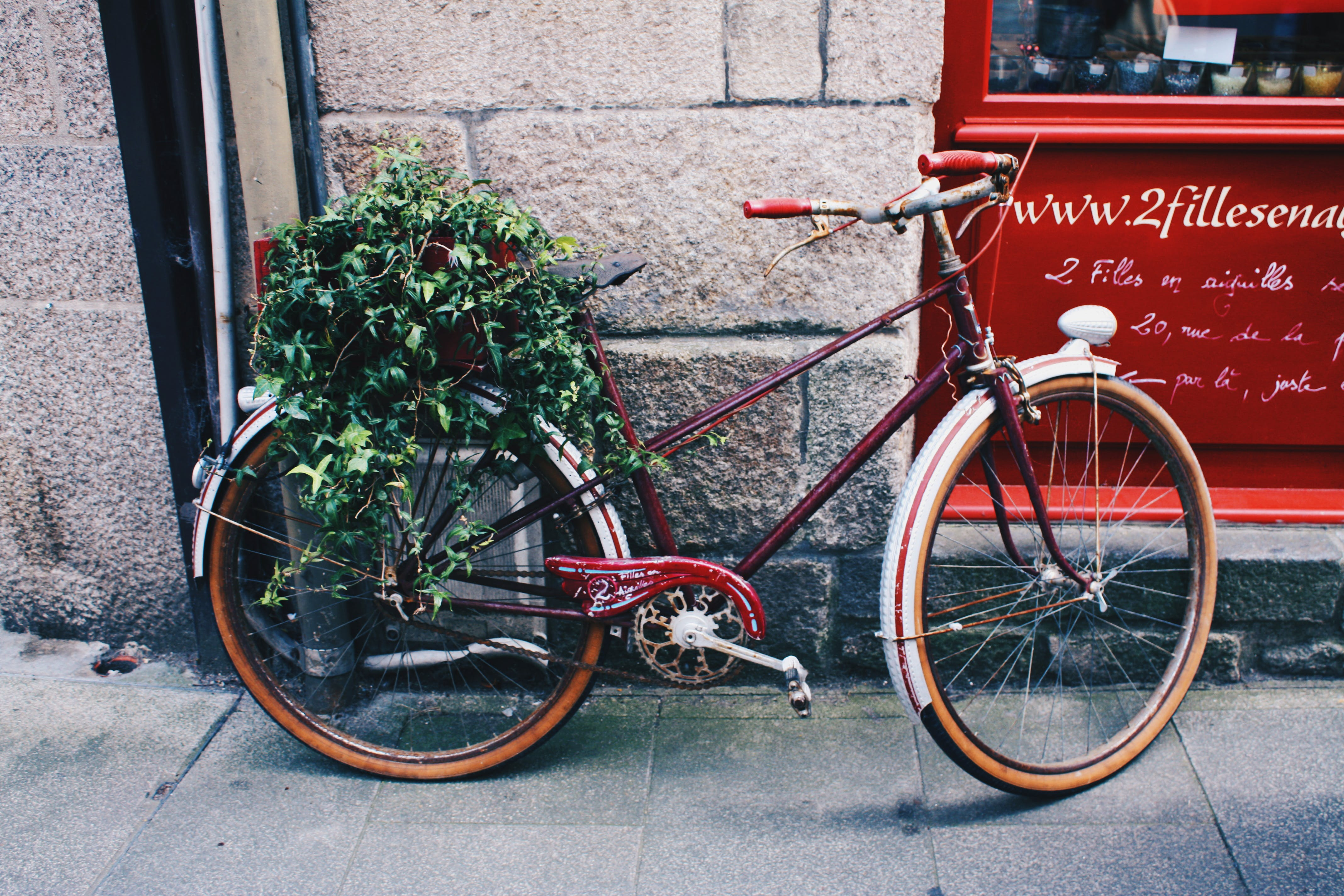 Red Mountain Bicycle in Front of Gray Wall