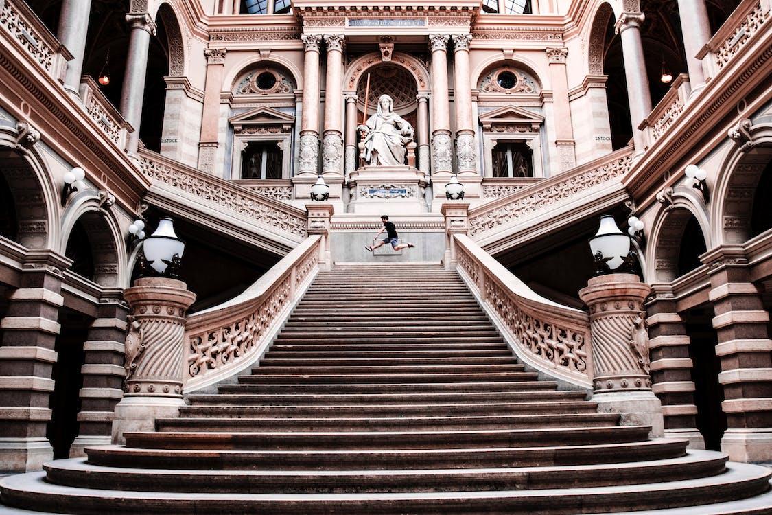 Man on Gray Concrete Staircase
