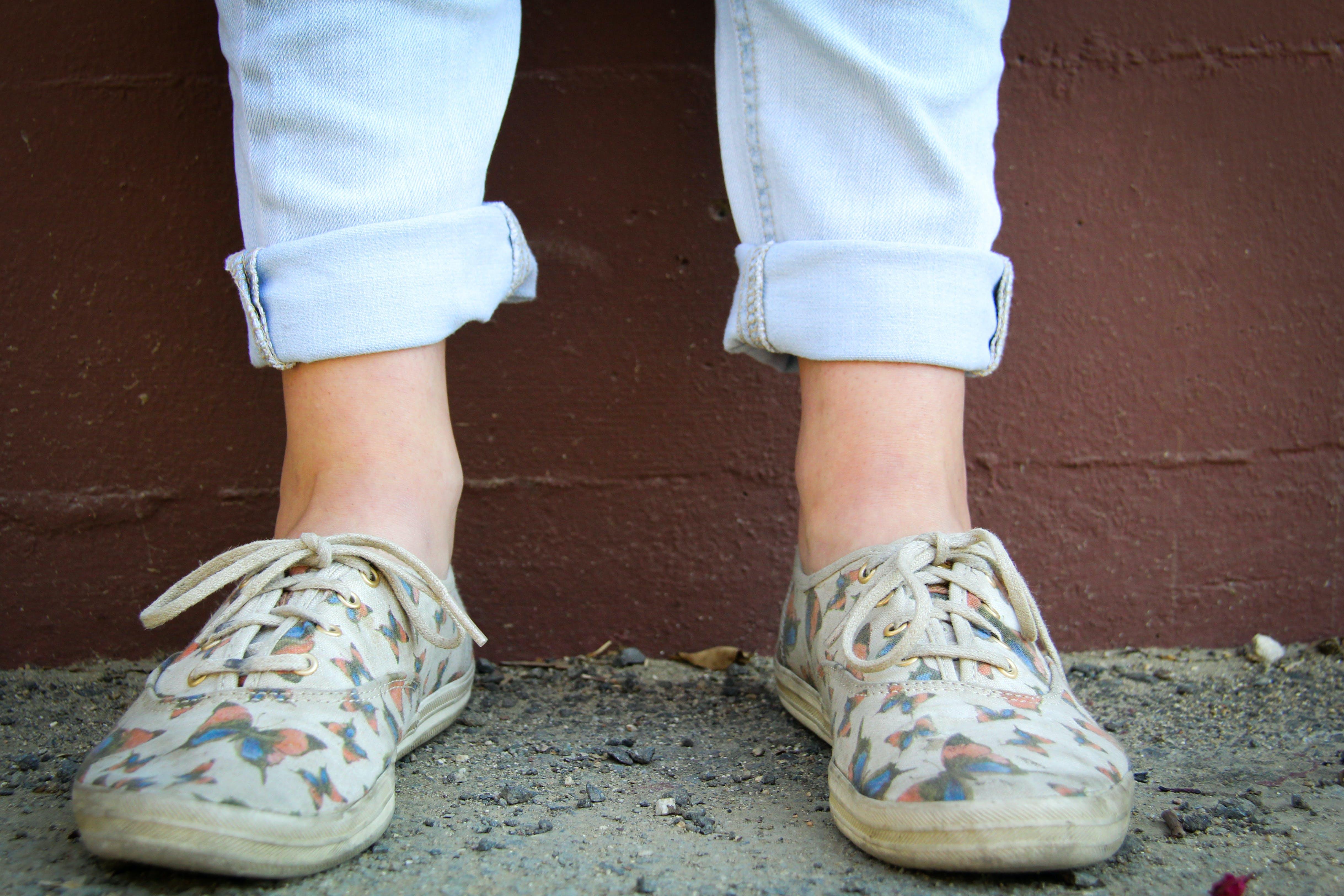 Person Wearing Brown Low-top Sneakers