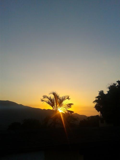 Free stock photo of blue sky, golden sun, mountain