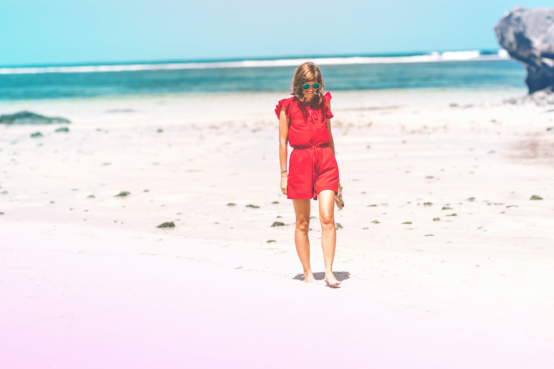 Woman Wearing Red Romper on Beach