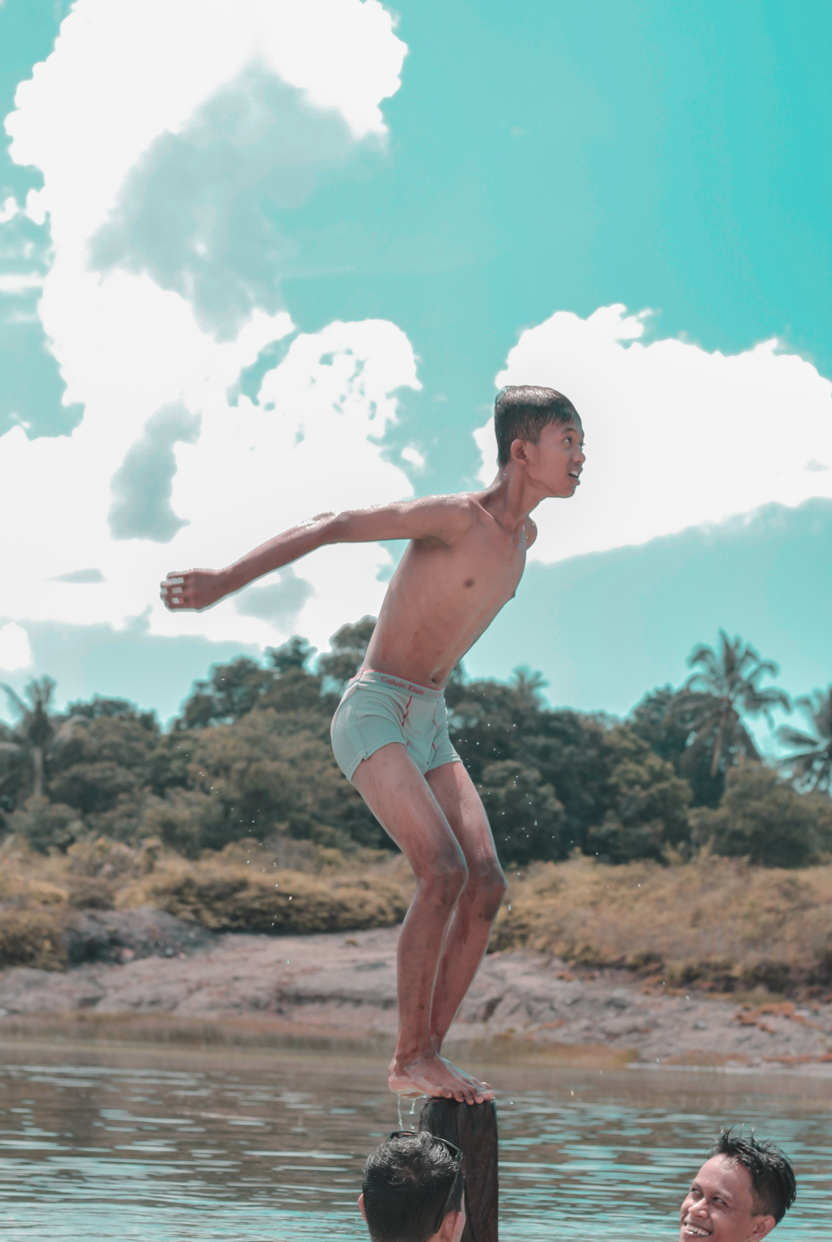 Man in Blue Underwear About to Jump