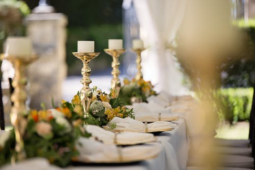 Selective Focus of Candlesticks on Table With Wedding Set-up