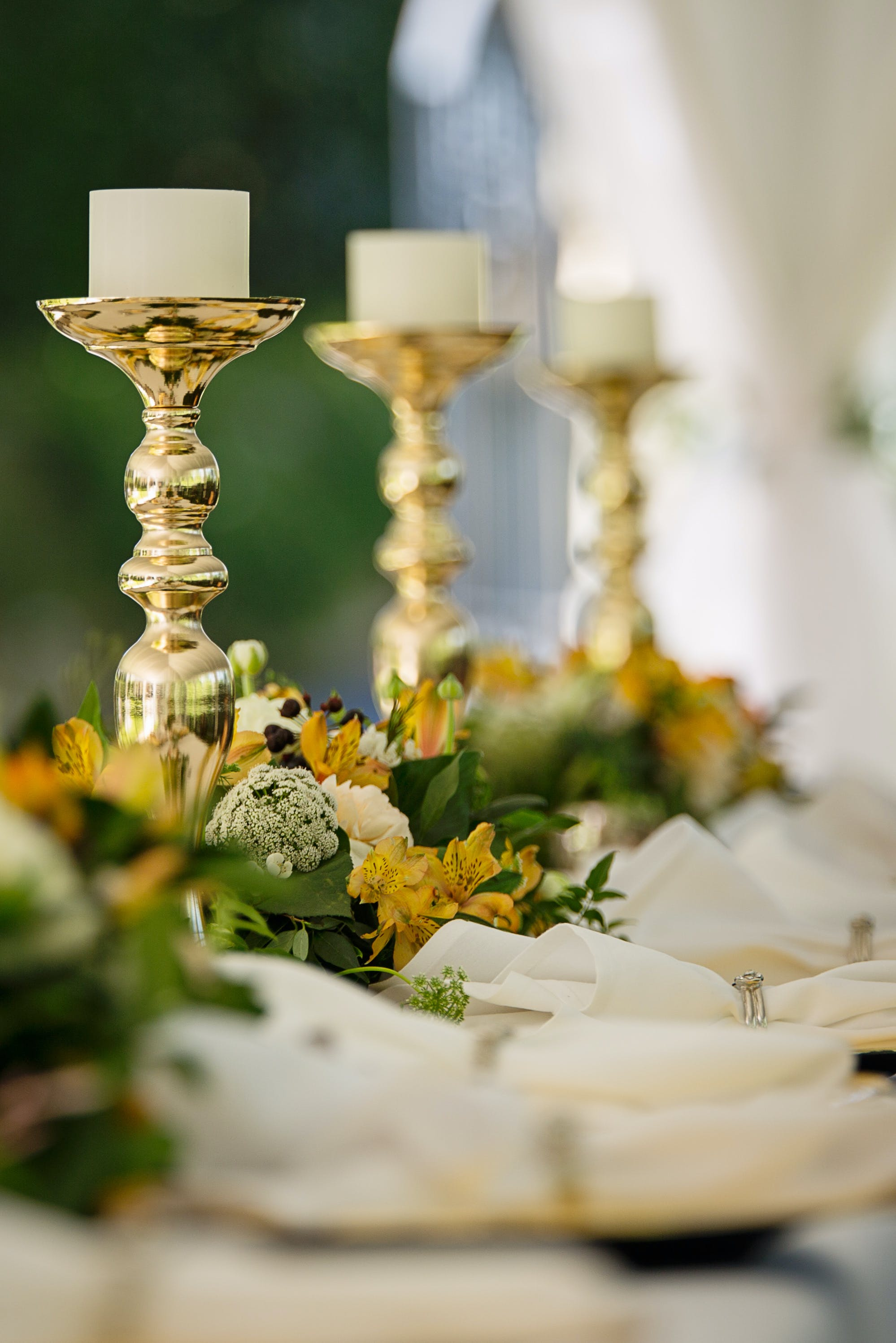 Selective Focus Photography of Gold Candlestick on Table