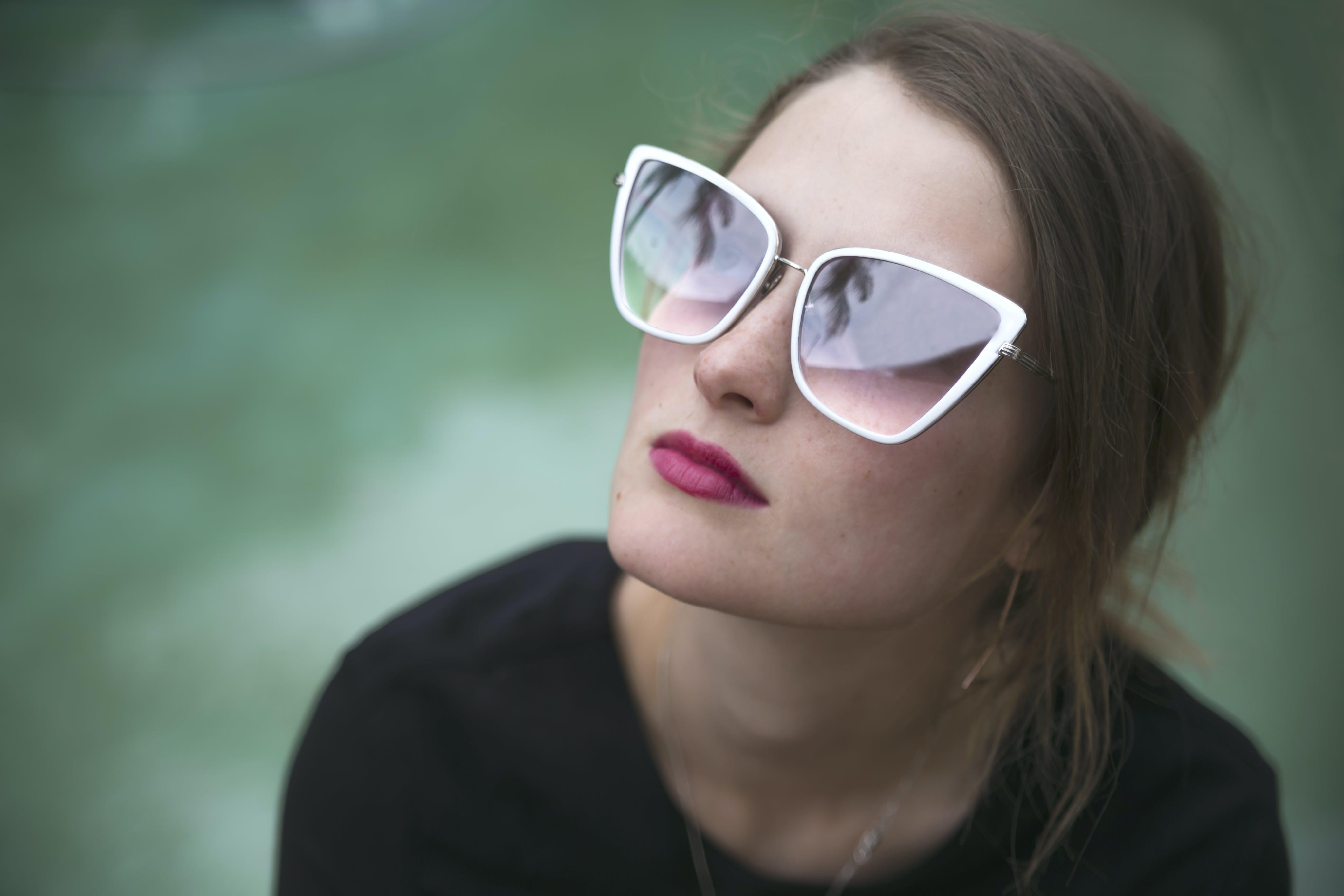 Woman Wearing Gray Framed Butterfly Sunglasses