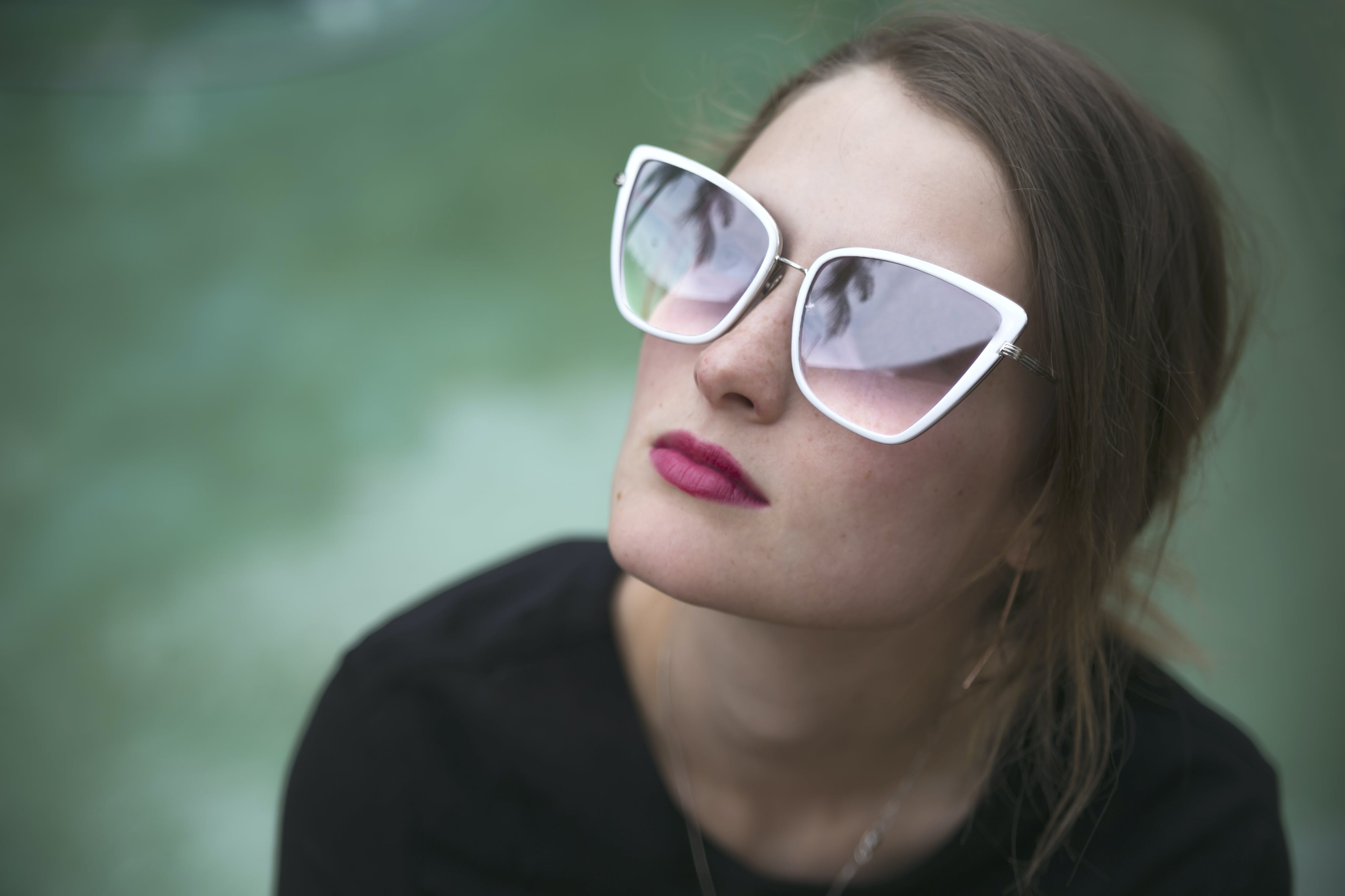 Woman Wearing Gray Framed Butterfly Sunglasses