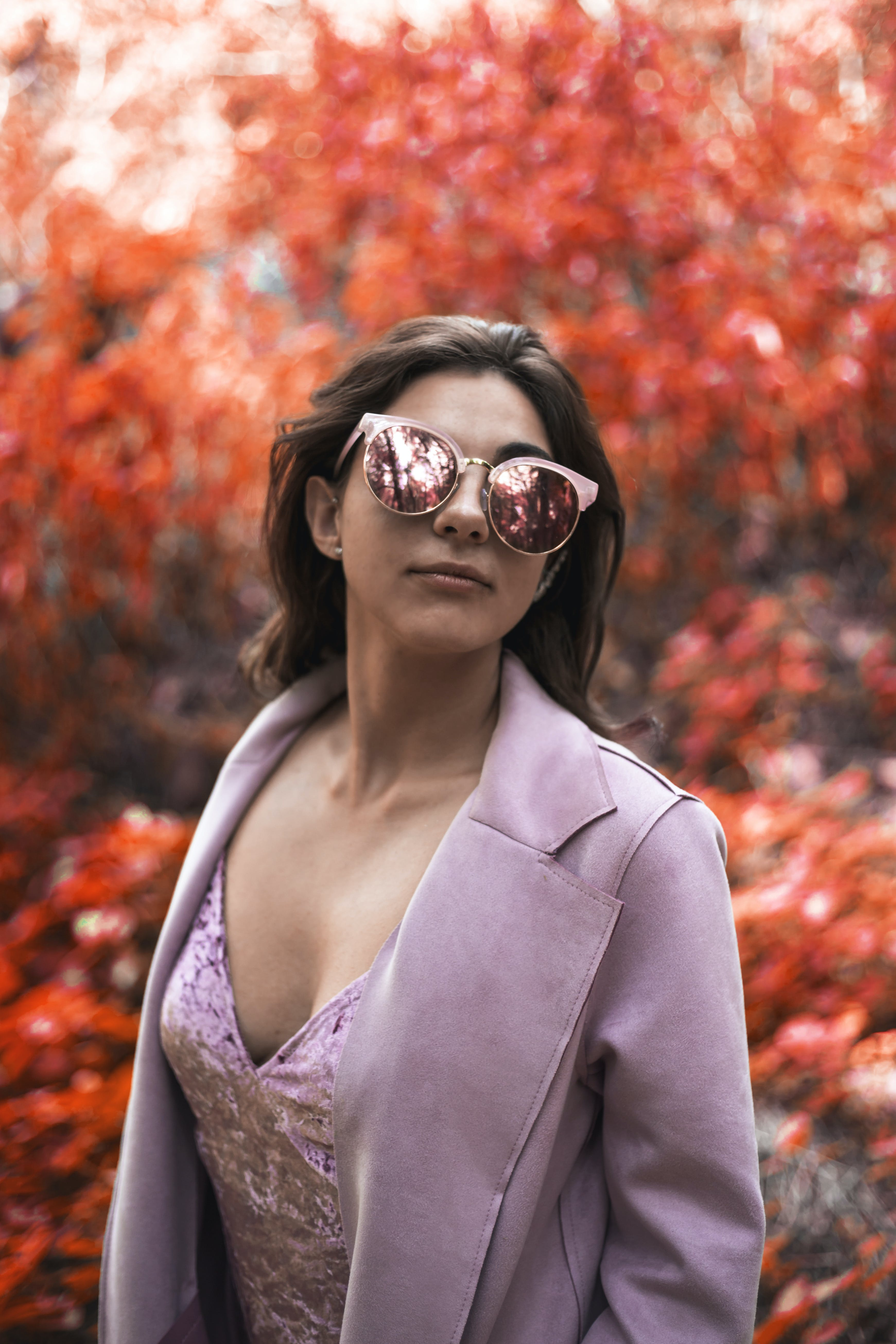 Woman Wearing Pink Blazer and Cat-eye Sunglasses