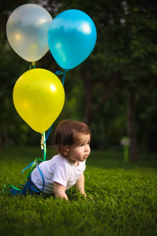 Baby Wearing White Shirt Tied With Three Balloons