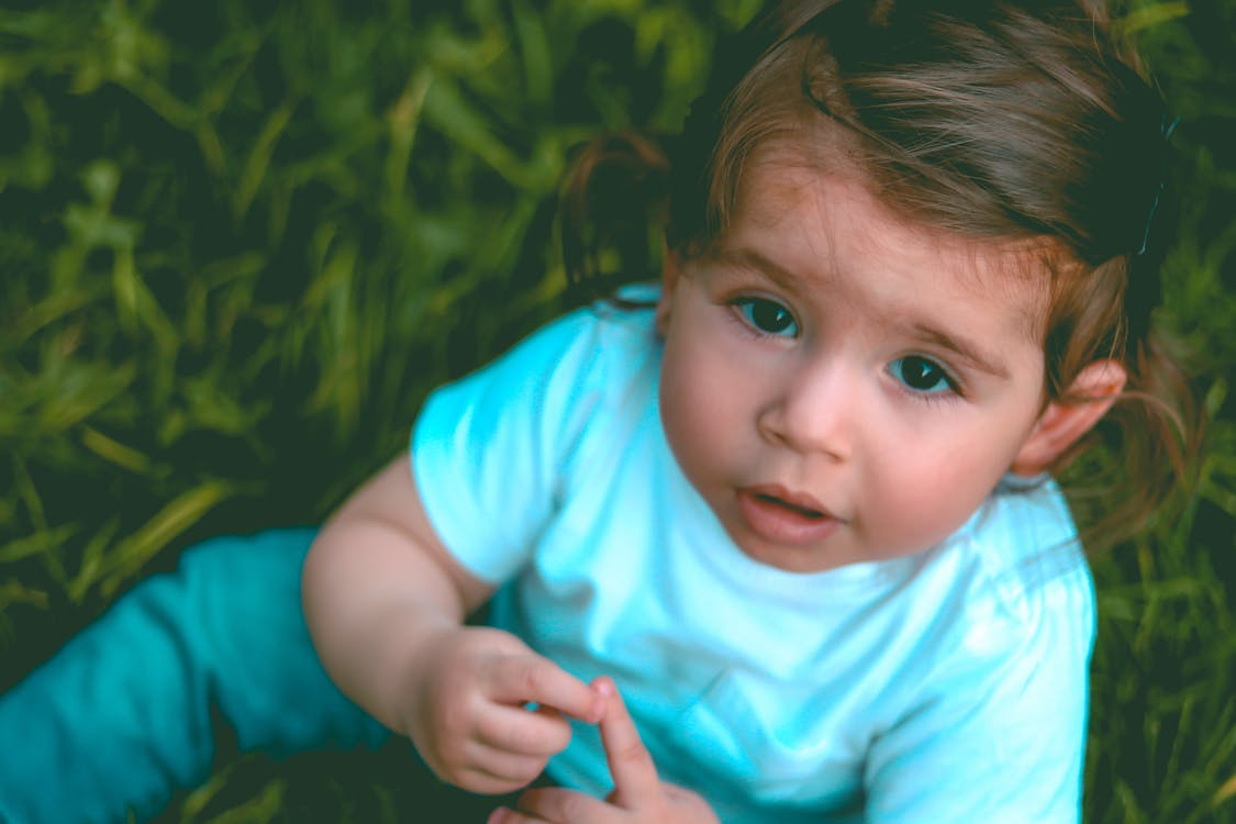 Close-Up Photography of a Baby Girl