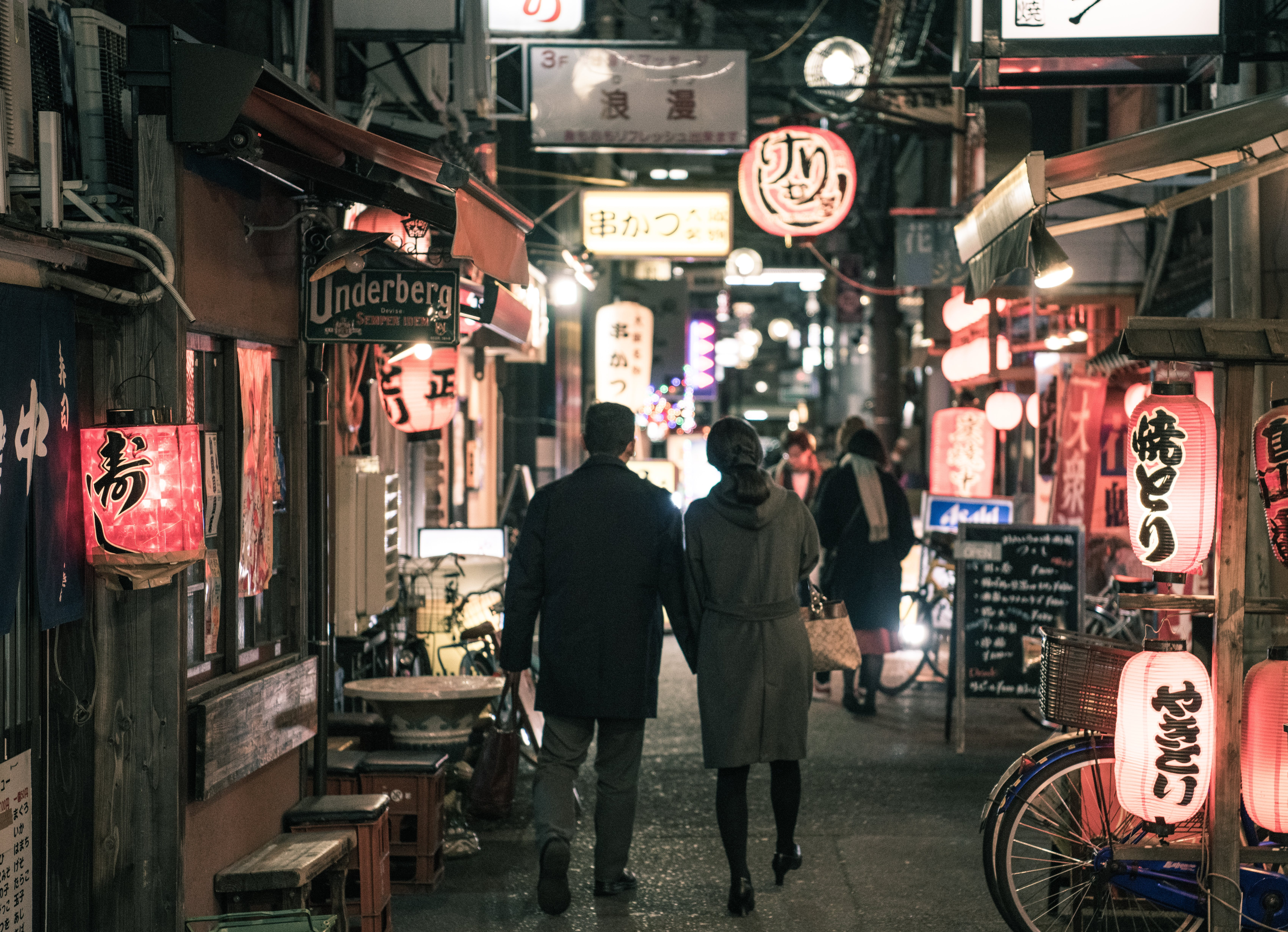 Couple Walking On Street At Night