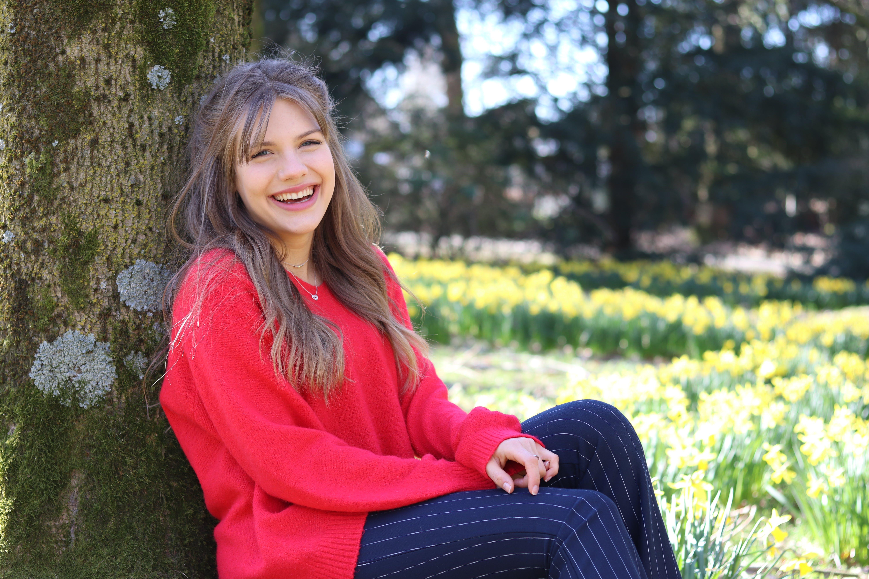 Smiling Woman Wearing Red Jacket