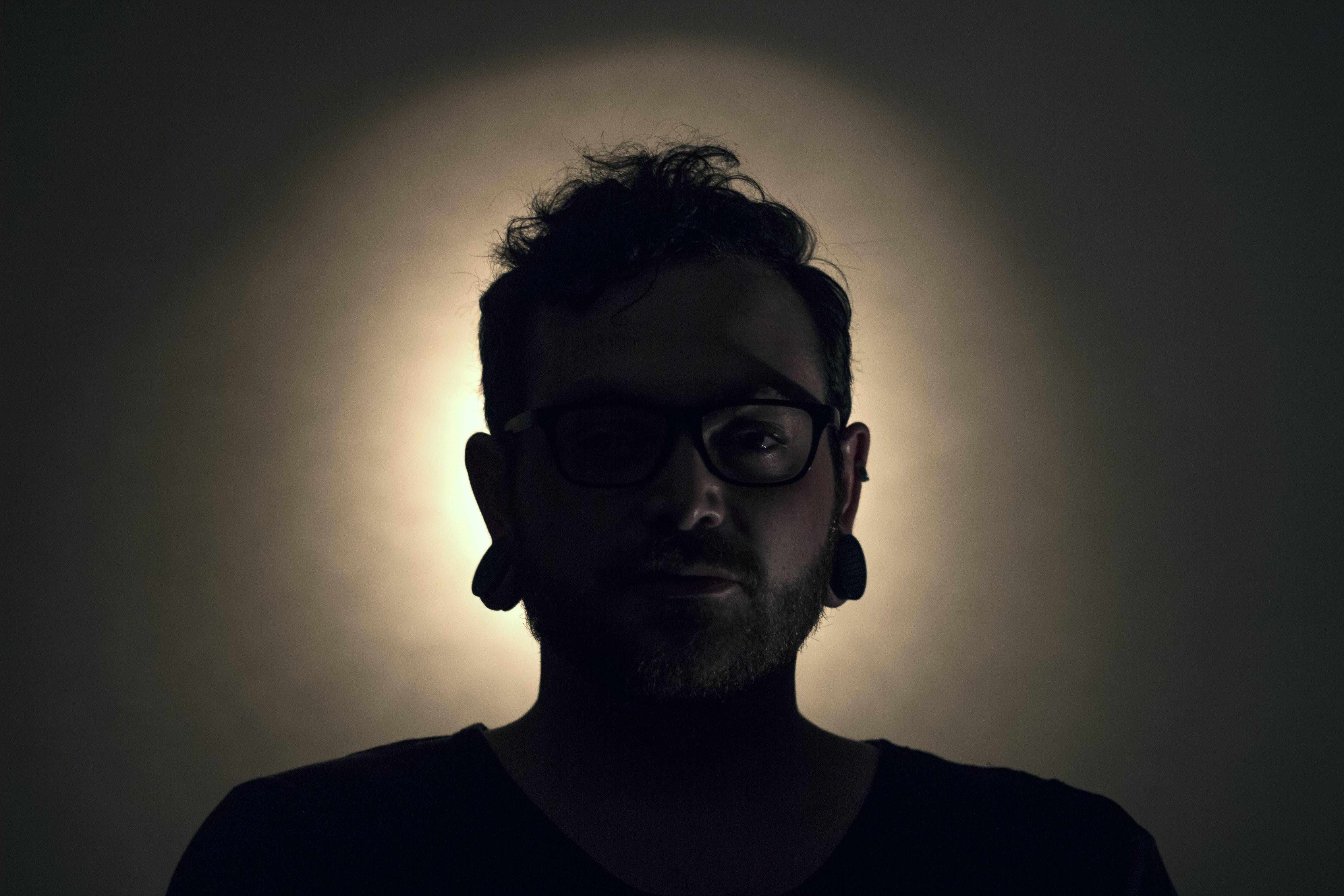 Man Wearing Black Shirt and Black Framed Eyeglasses