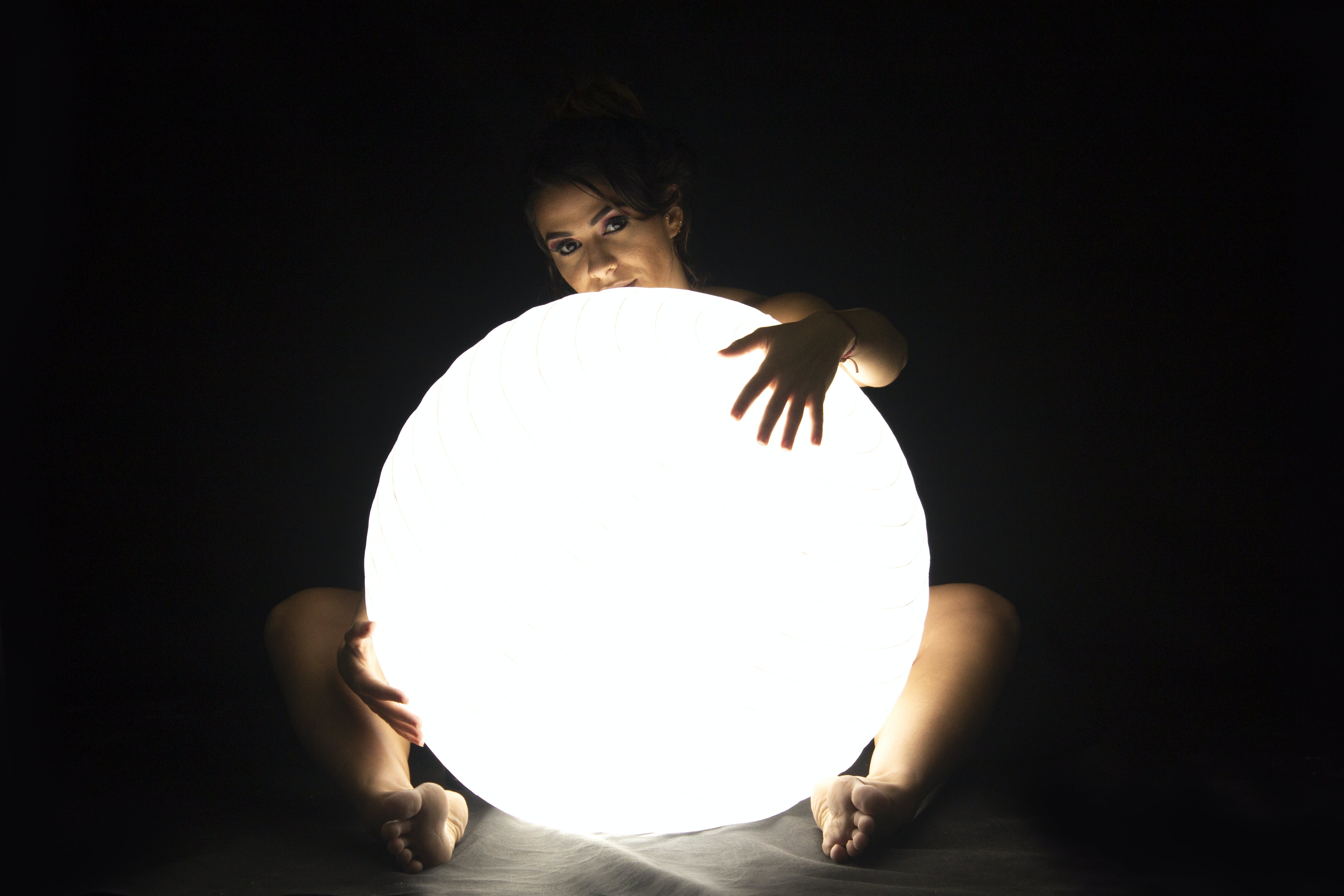 Woman Holds Led Large Ball