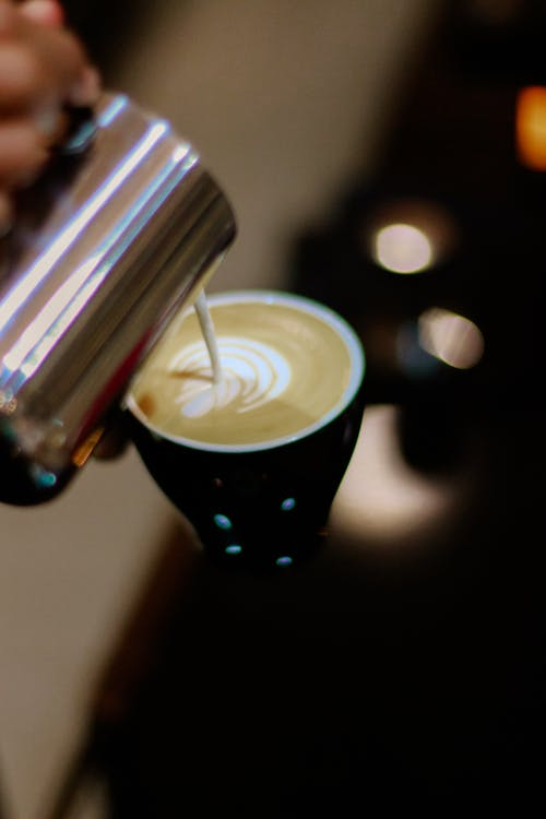 Close-up Photography of Latte Art Making