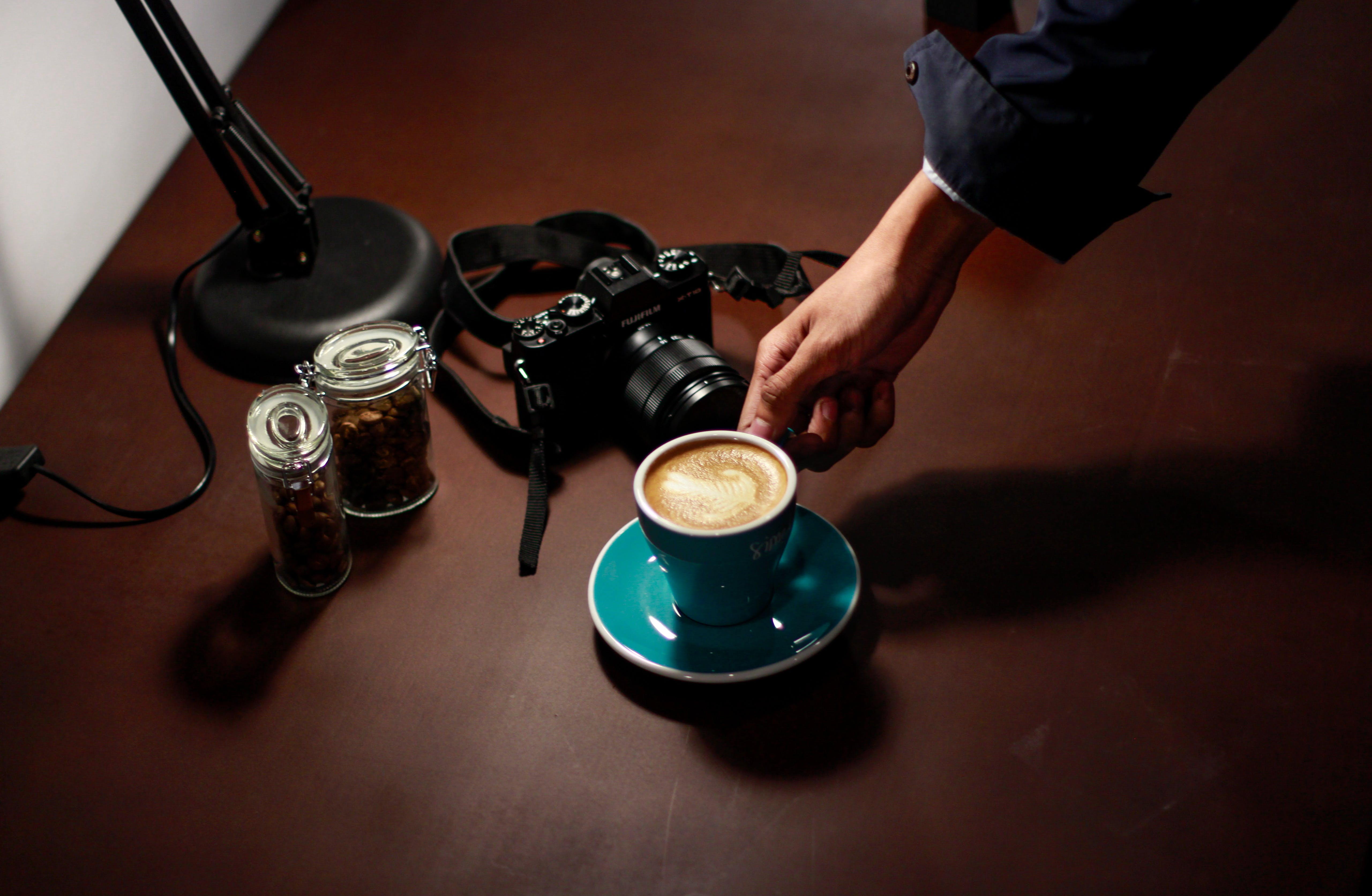 Free stock photo of coffee, cup, hand, camera
