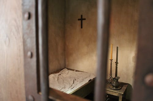Free stock photo of candles, cross, jail