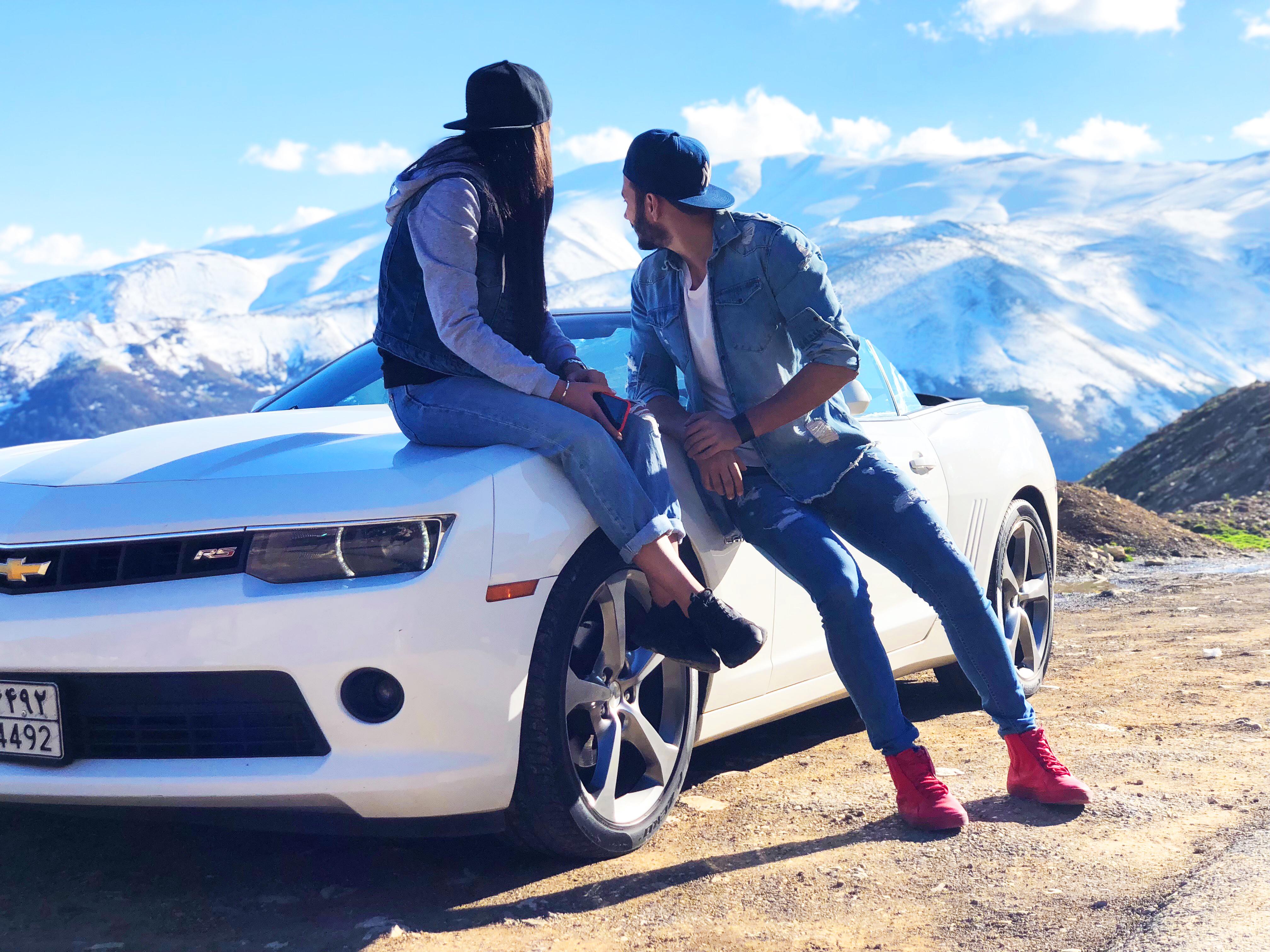 Couple Near White Chevrolet Coupe