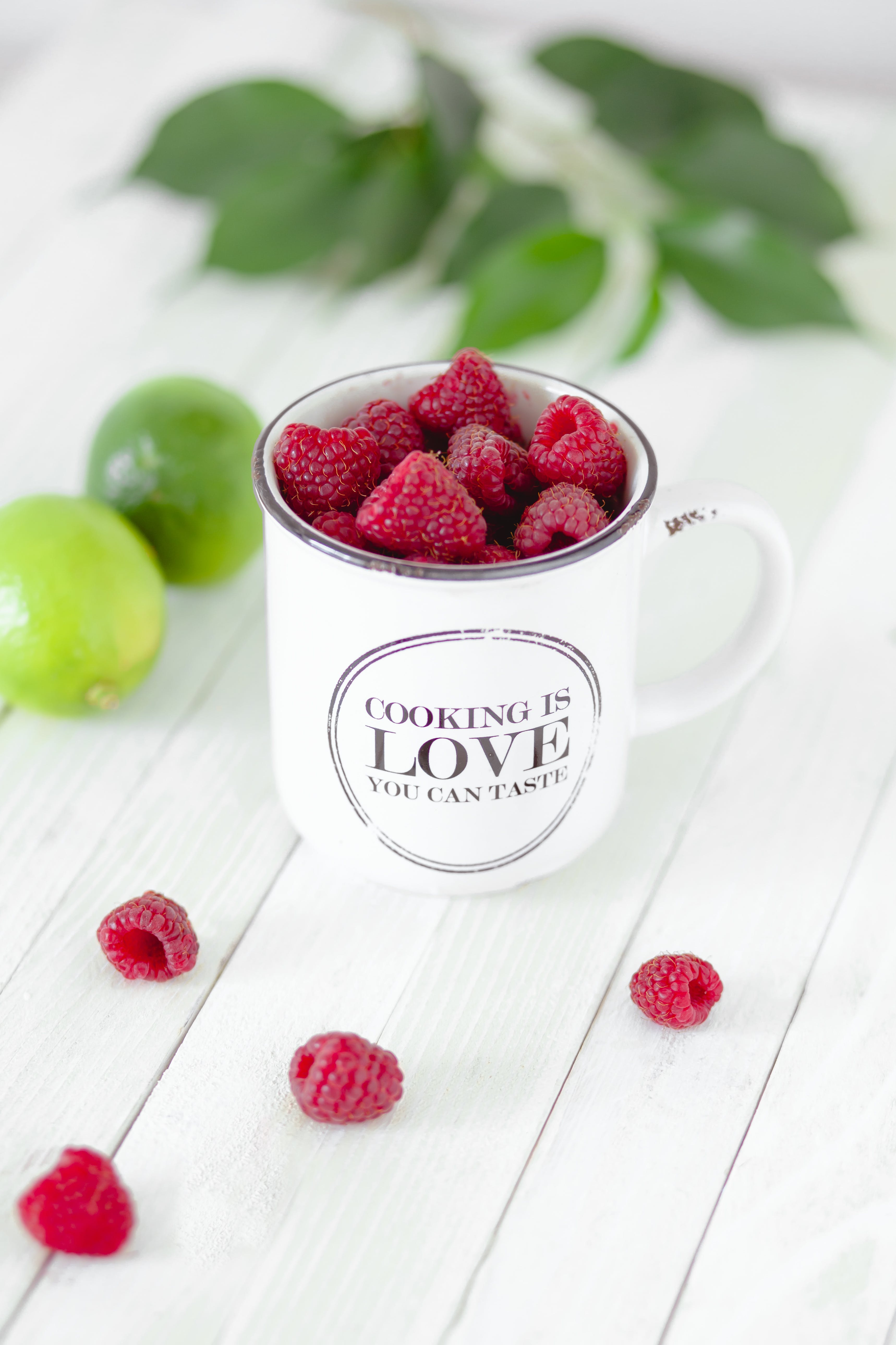 Close-Up Photography of Raspberries on Cup