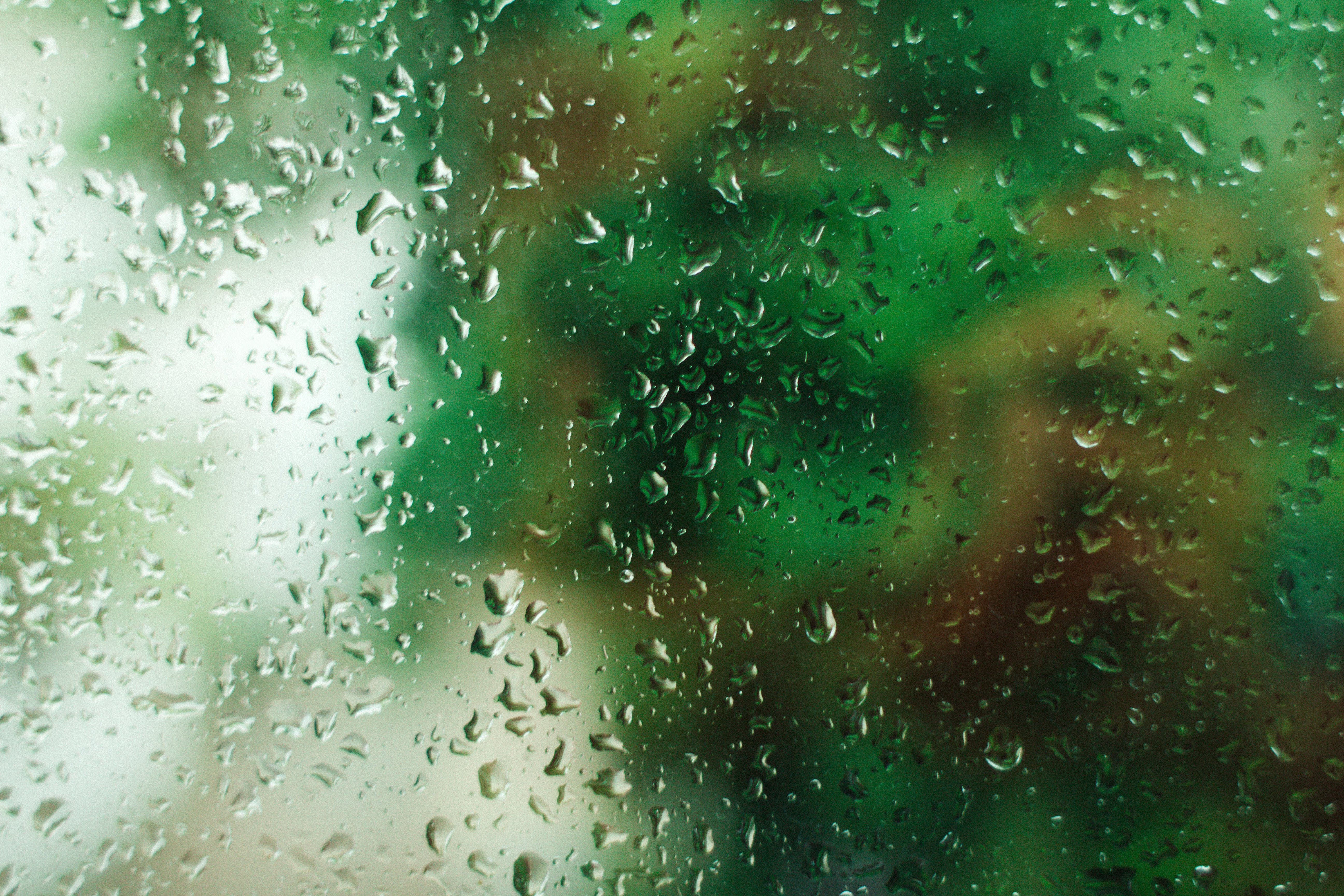 Close-Up Photography of Droplets on Glass