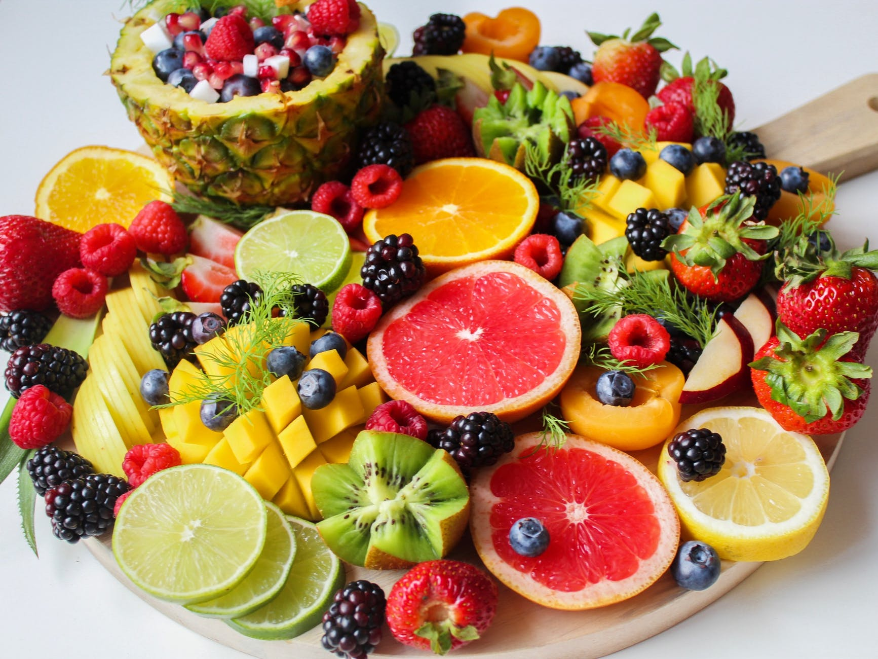 Photo of a wooden pan with assorted fruits