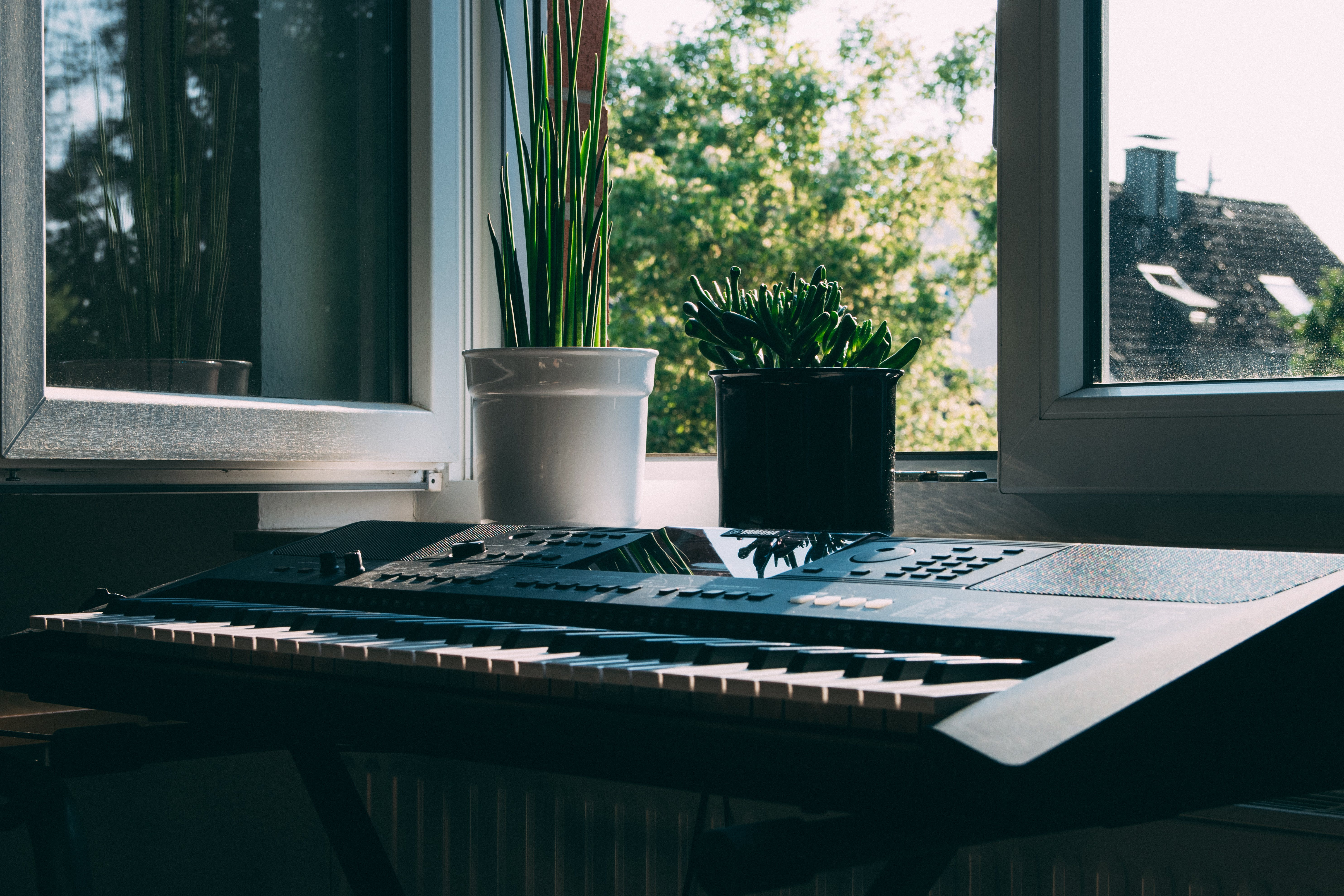 Black Electronic Keyboard Near Window