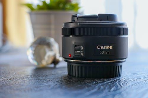Gratis stockfoto met 50 milimeter, camera-apparatuur, cameralens, canon