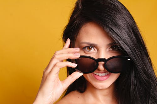Smiling Woman Wearing Black Sunglasses