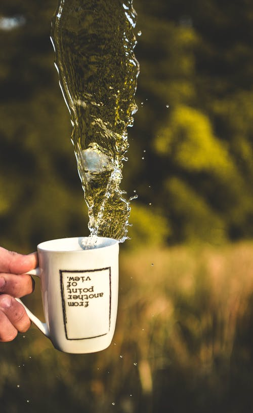 Time Lapse Photography Of Water In Cup