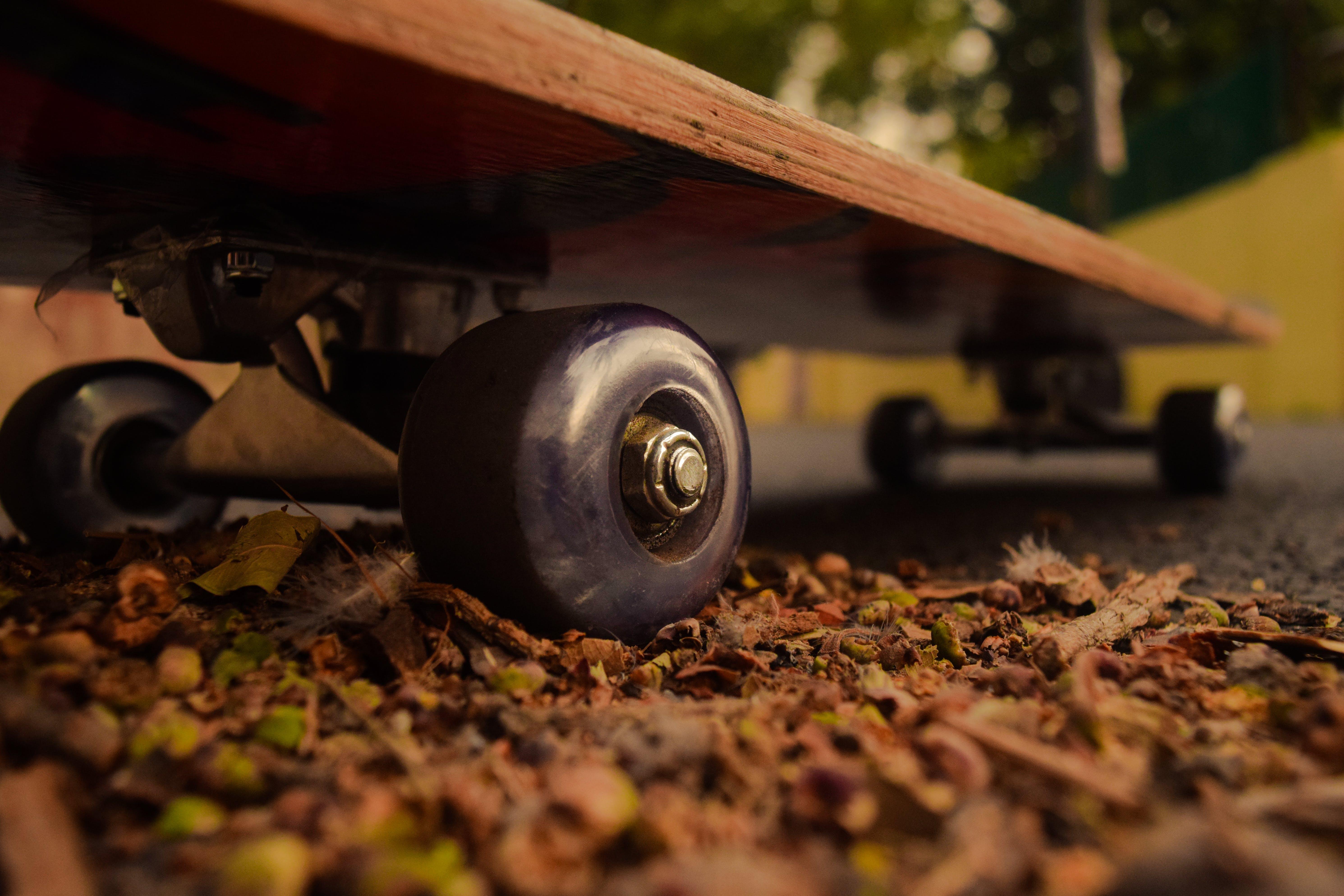 Brown Skateboard on Ground