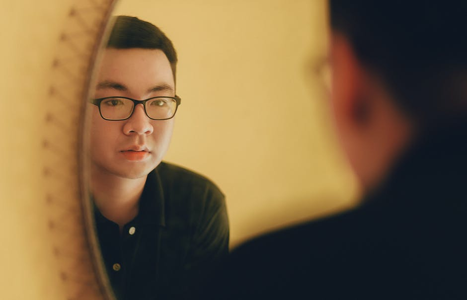 Photo of Man Looking at the Mirror