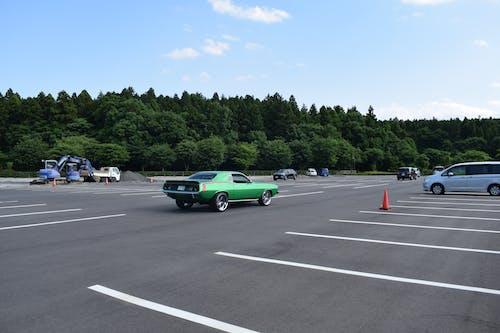Free stock photo of car, car parking, clouds, green car