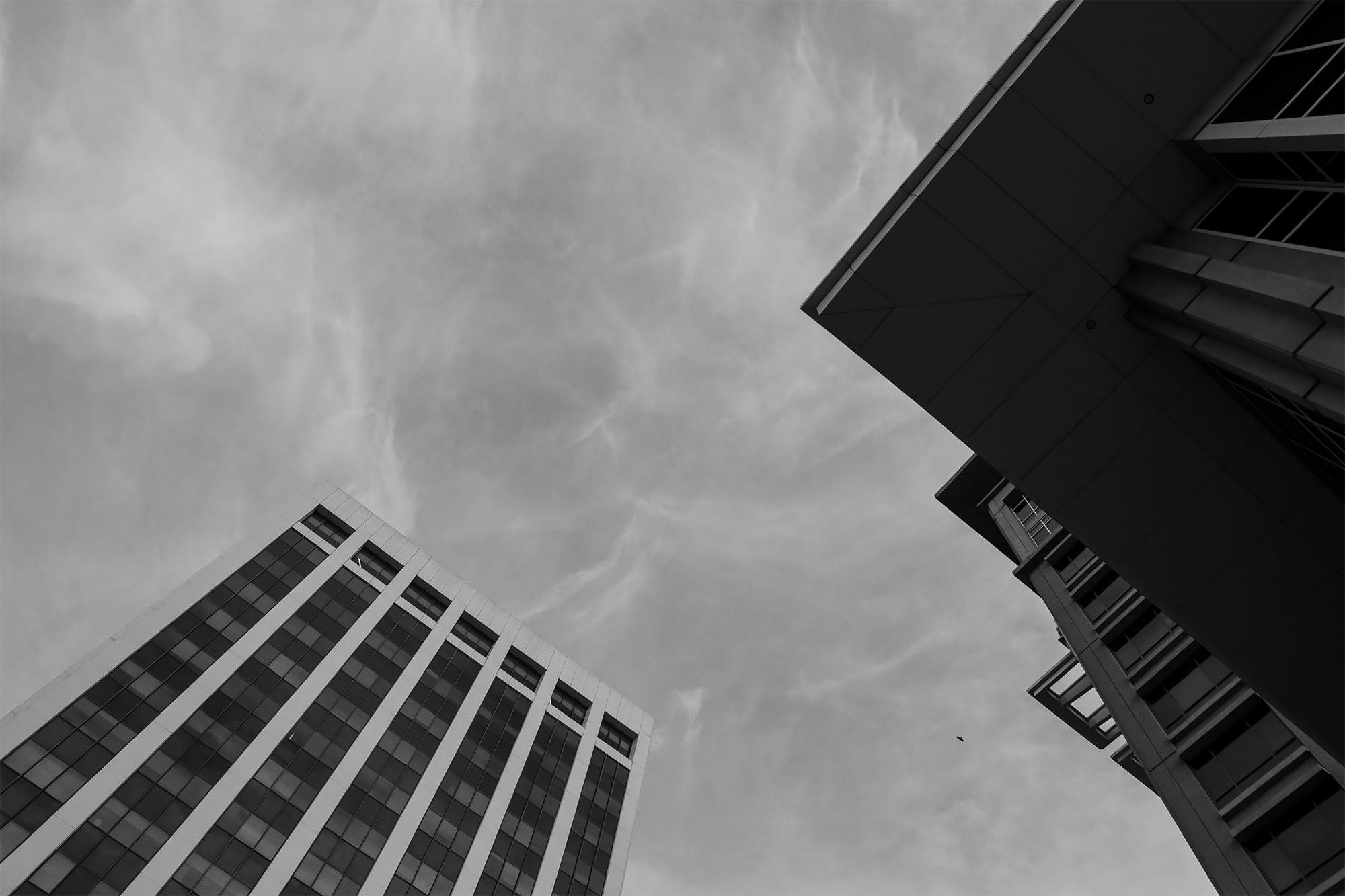Free stock photo of black and white, buildings, city, clouds