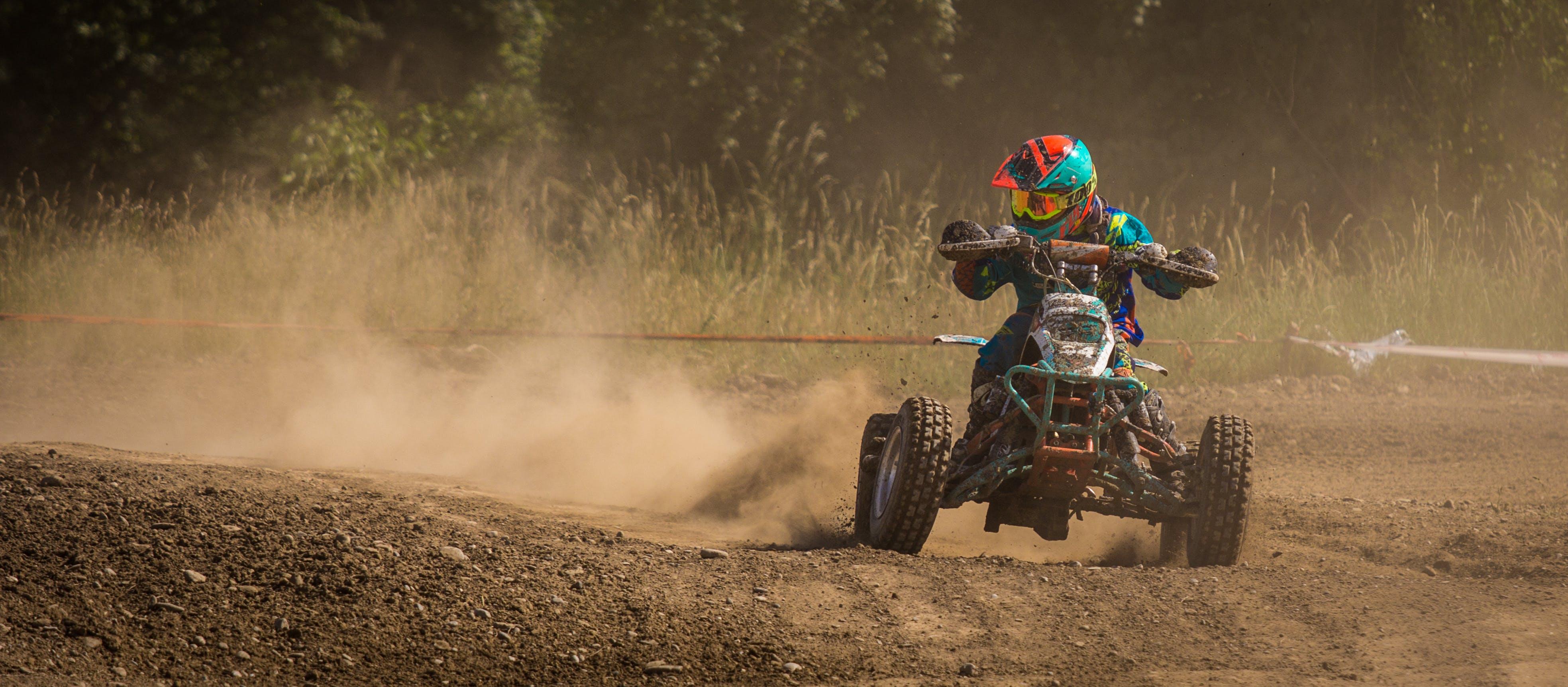 Man Riding Atv on Race Track