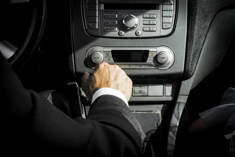 Man in Black Suit Inside Car
